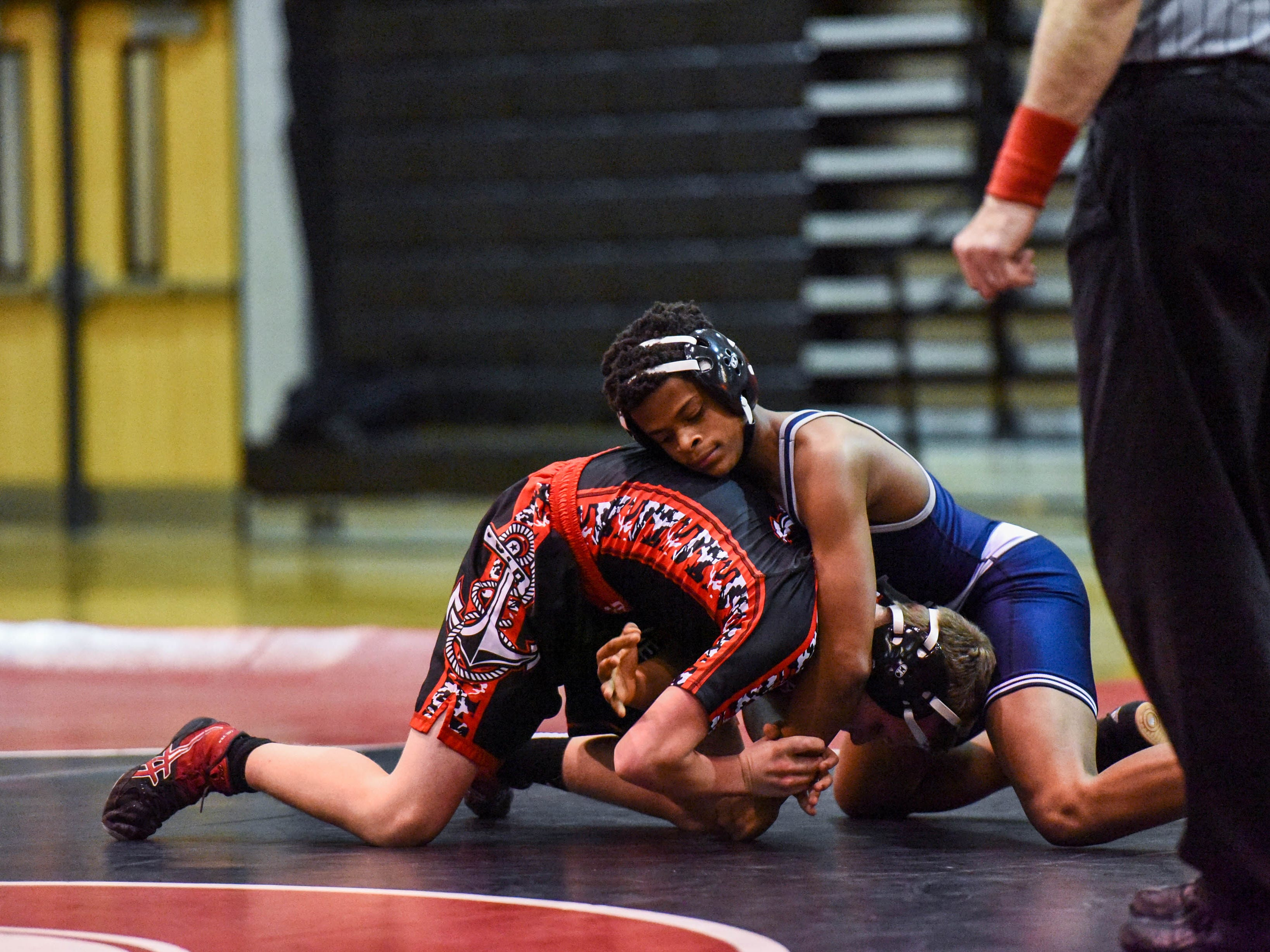 Kent Island's Cameron Faulkner competes in a wrestling match against Bennett's Aiden Hugues at Bennett High on Wednesday, Jan 9, 2018.