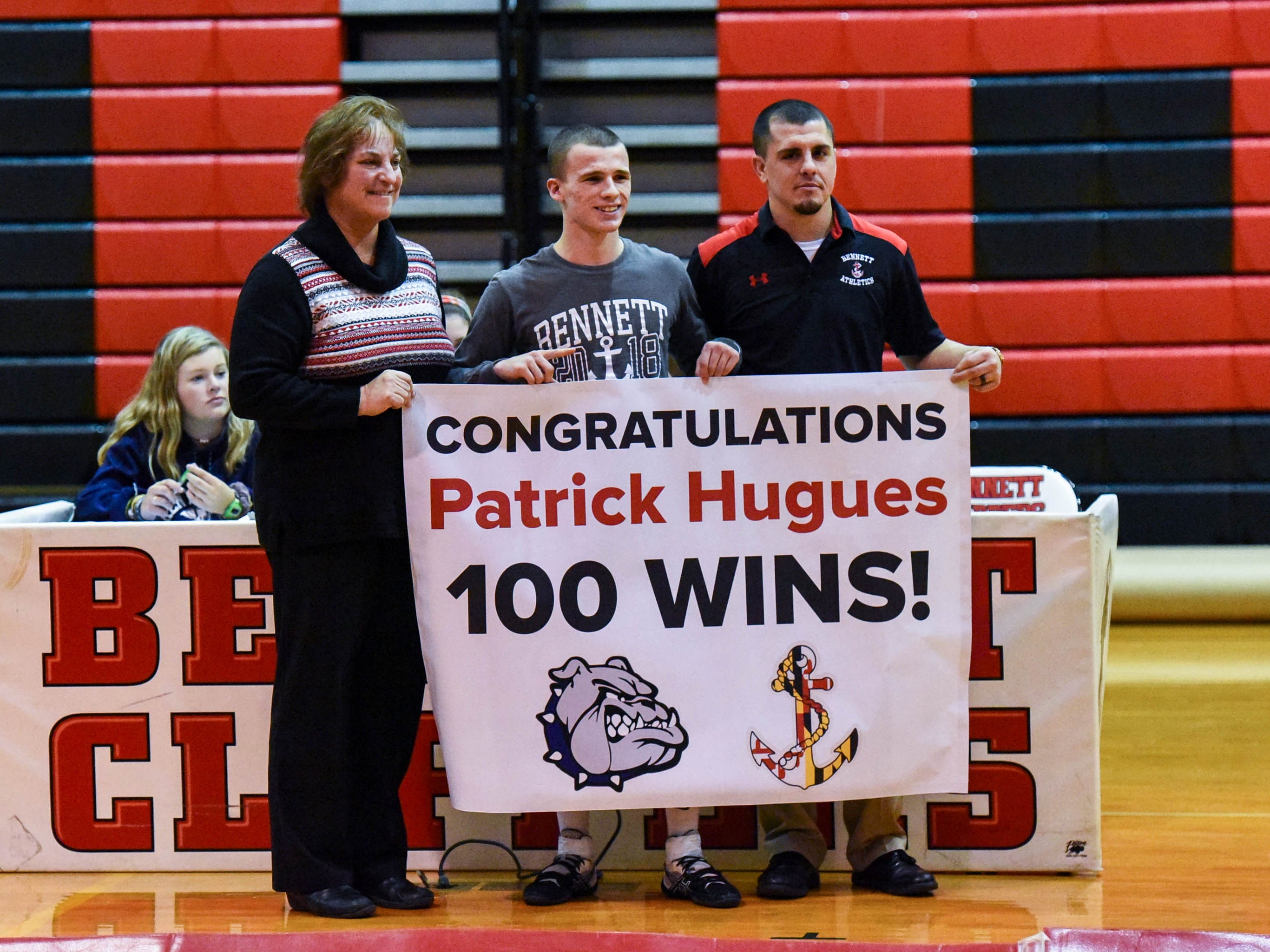 Bennett's Patrick Hugues is honored for his record wins at Bennett High on Wednesday, Jan 9, 2018.