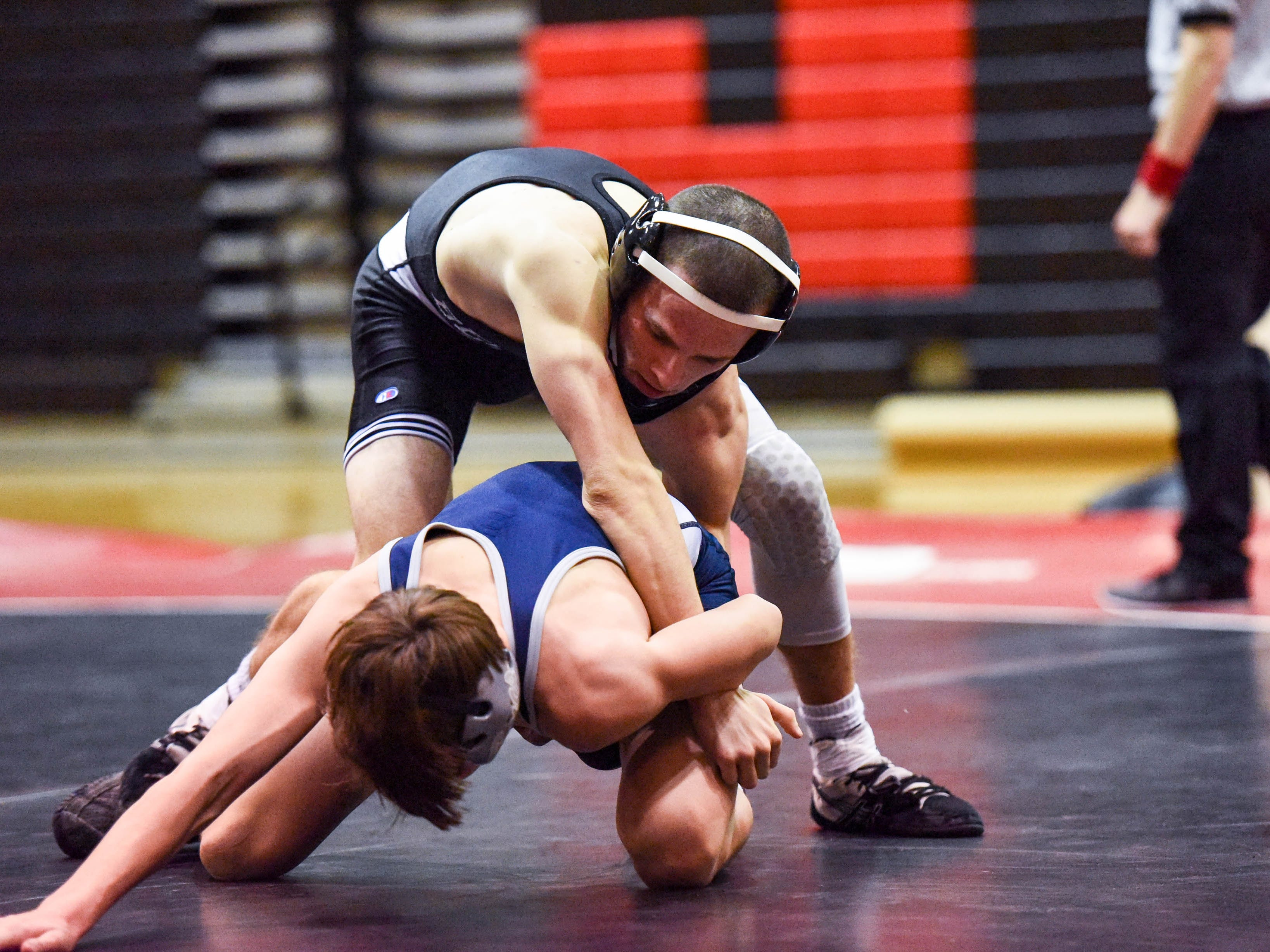 Bennett's Patrick Hugues competes against Kent Island's Jack Mulligan in a wrestling match at Bennett High on Wednesday, Jan 9, 2018.