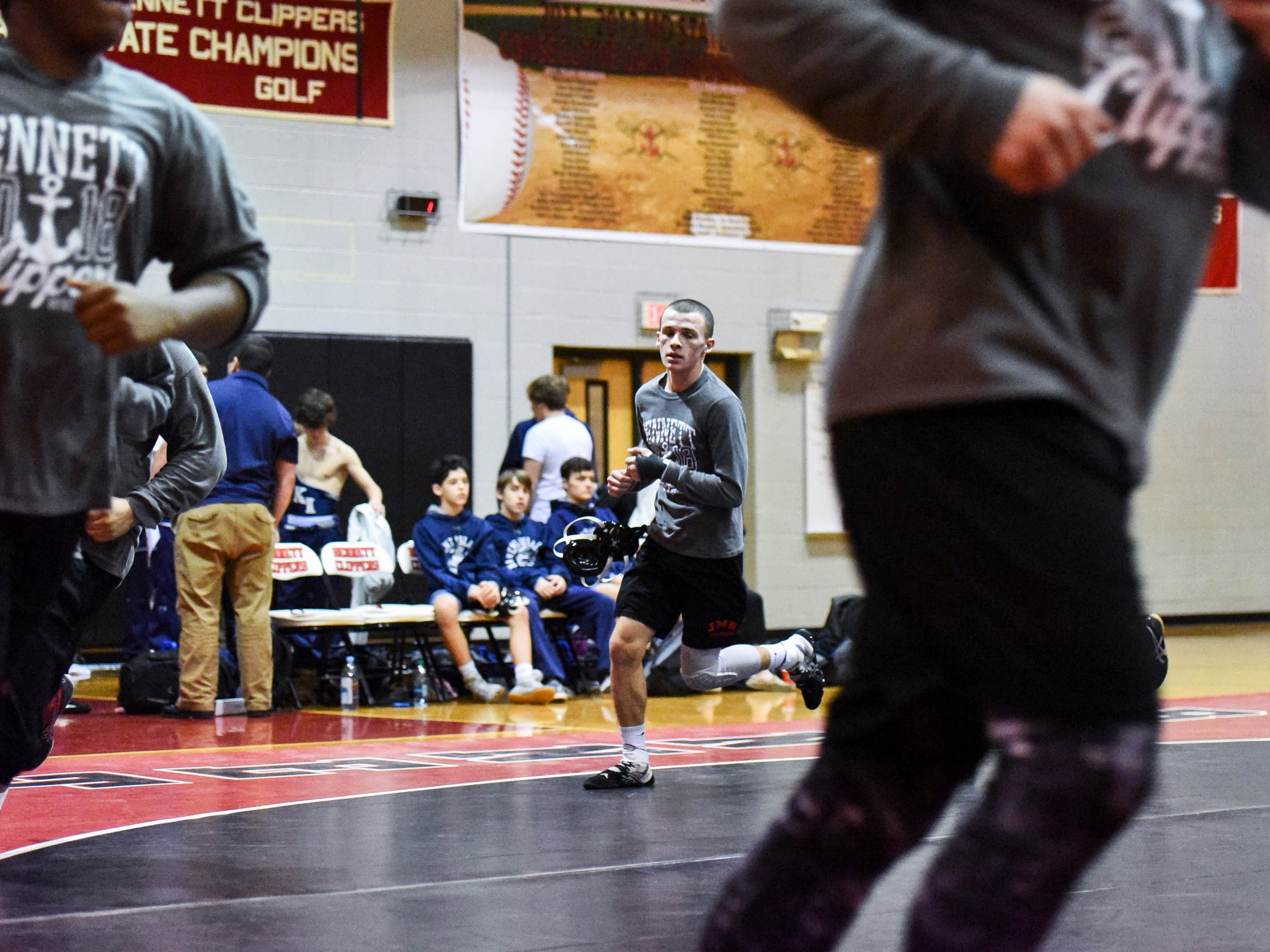 Bennett's Patrick Hugues warms up for a wrestling match against Kent Island at Bennett High on Wednesday, Jan 9, 2018.
