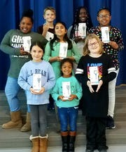 Kiptopeke Elementary School students show their new Kinsa QuickCare thermometers.