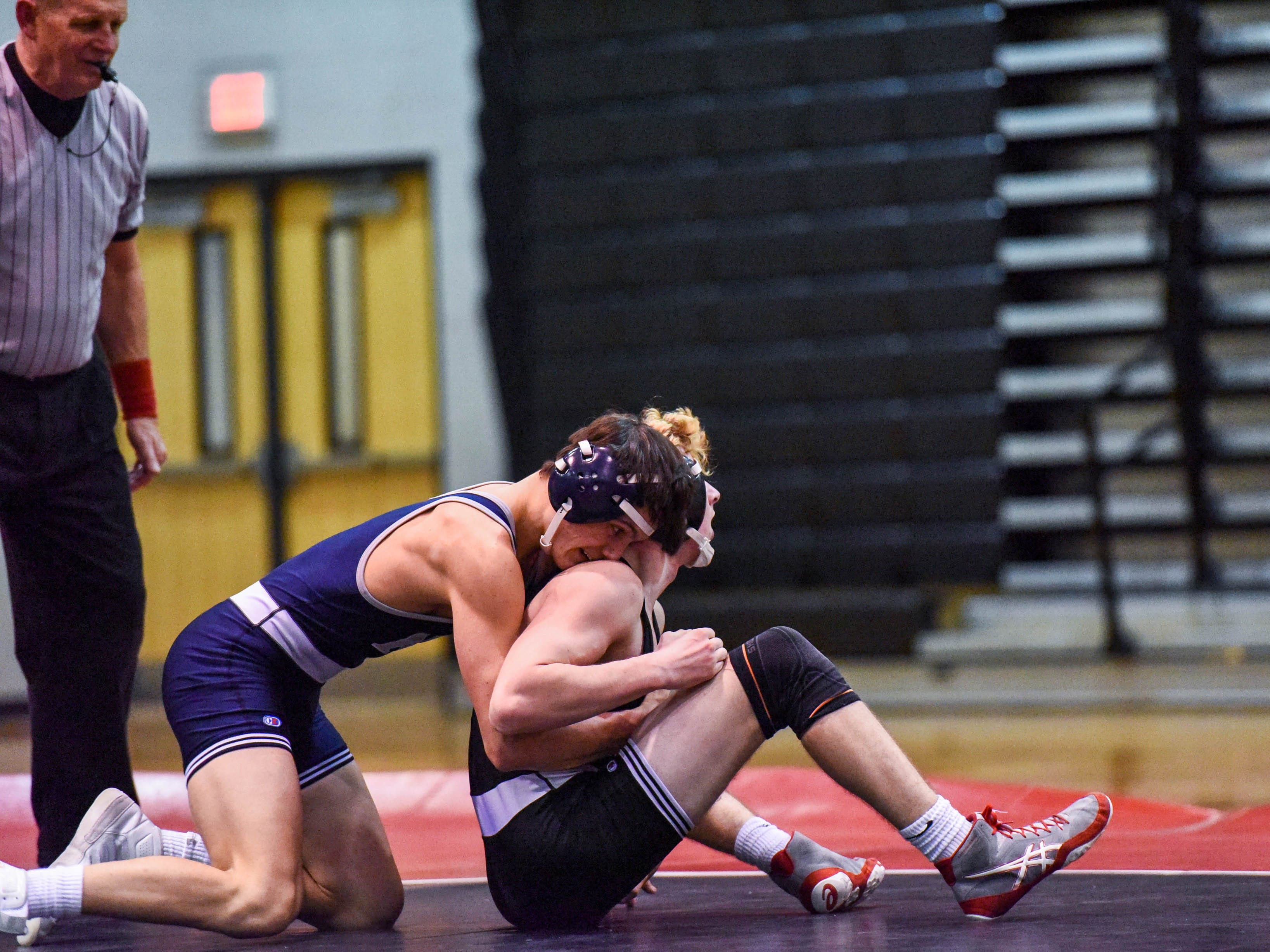 Kent Island's Matt Miller competes in a wrestling match against Bennett's Jeremy Cope at Bennett High on Wednesday, Jan 9, 2018.
