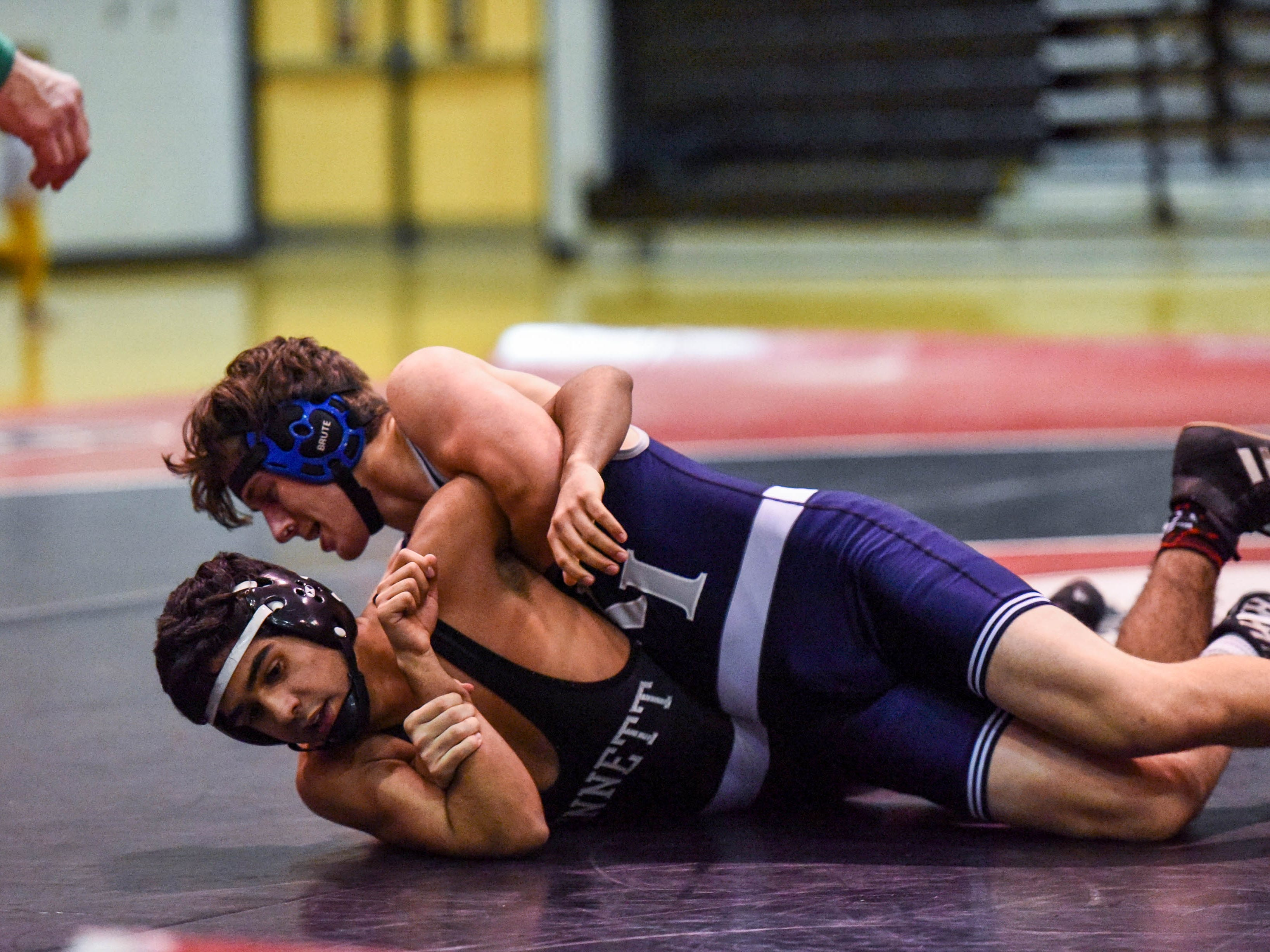 Bennett's Ryan Hedger competes in a wrestling match against Kent Island's Jared Silva at Bennett High on Wednesday, Jan 9, 2018.
