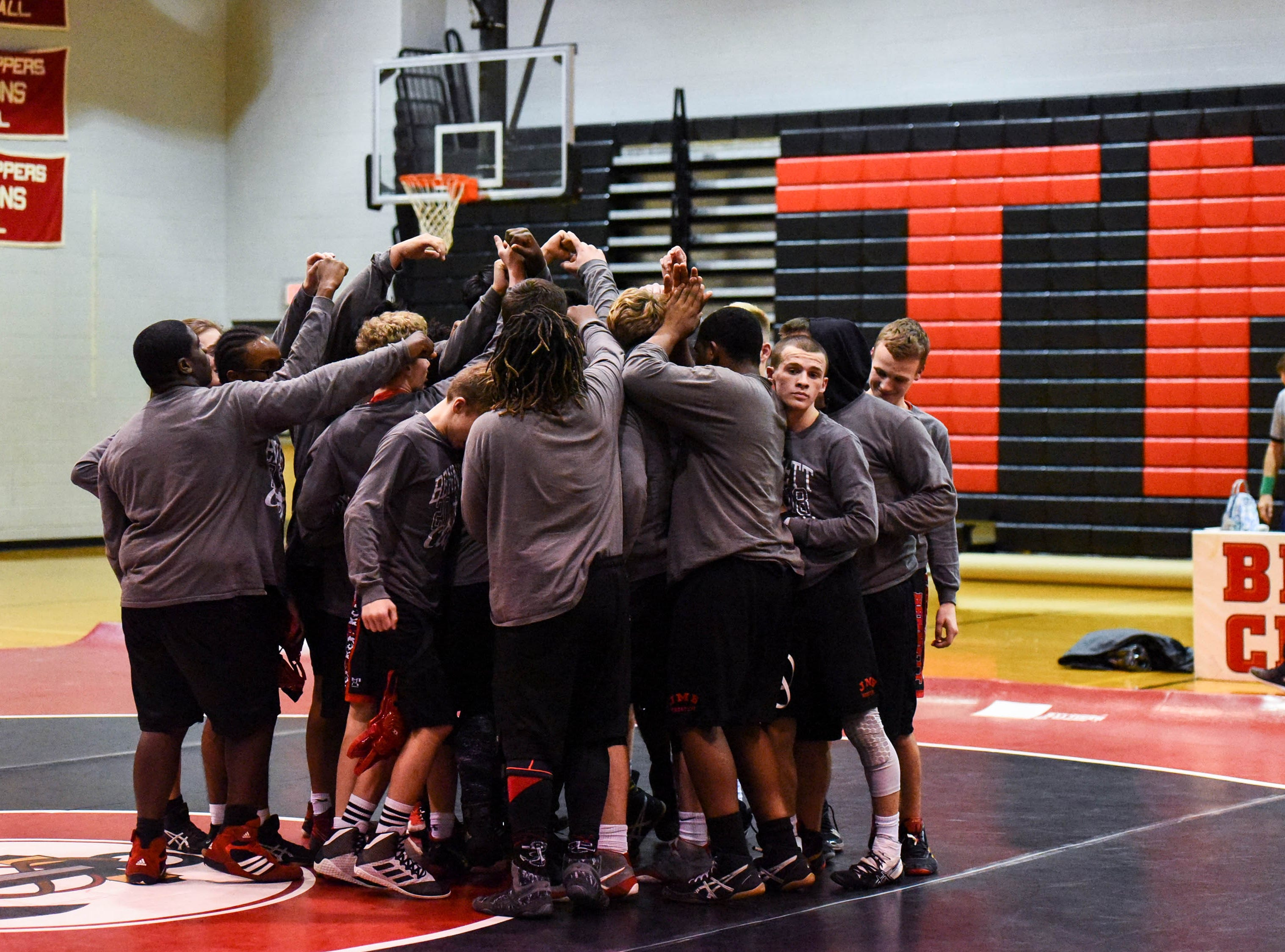 The Bennett team prepares for a wrestling match against Kent Island at Bennett High on Wednesday, Jan 9, 2018.