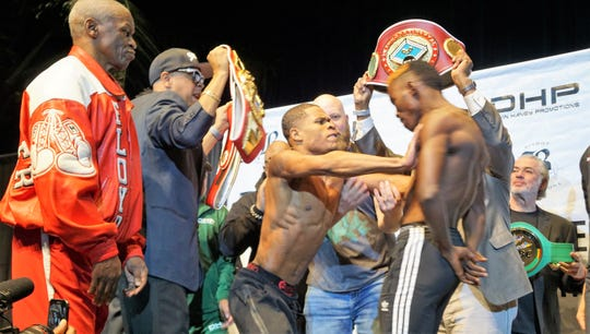 Devin Haney (center) pushes Xolisani Ndongeni during weigh-ins for Friday's fights at StageWorks of Louisiana.