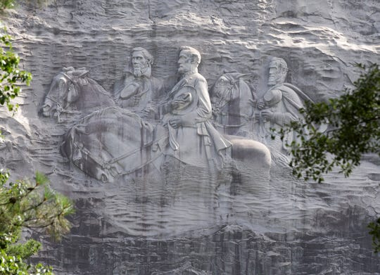 "FILE - This June 23, 2015, file photo shows a carving depicting Confederates Stonewall Jackson, Robert E. Lee and Jefferson Davis in Stone Mountain, Ga. A coalition of civil rights groups in Atlanta is using this year's Super Bowl to kick off a renewed ""war on the Confederacy"" in a fight to remove Confederate monuments around the nation."