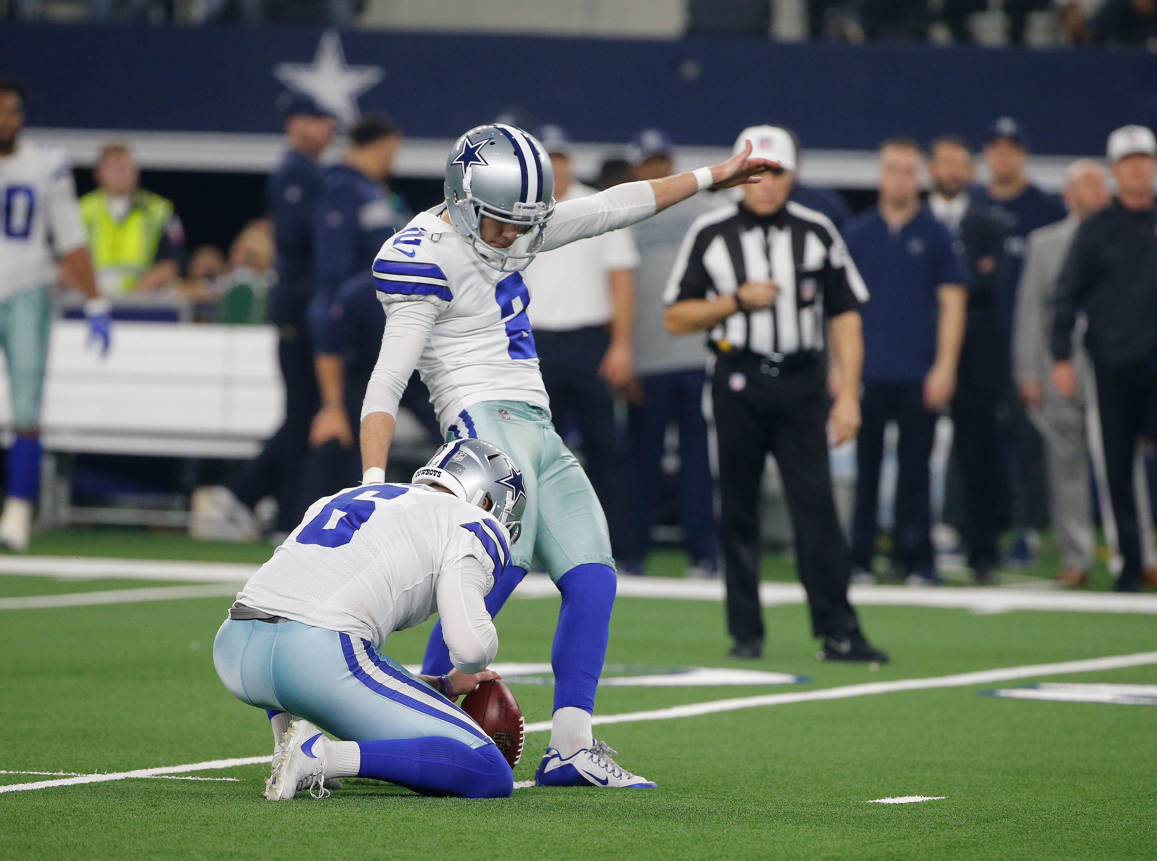Dallas Cowboys kicker Brett Maher (2) kicks a 39-yard field goal against the Seattle Seahawks first half of the NFC wild-card NFL football game in Arlington, Texas, Saturday, Jan. 5, 2019. (AP Photo/Michael Ainsworth)