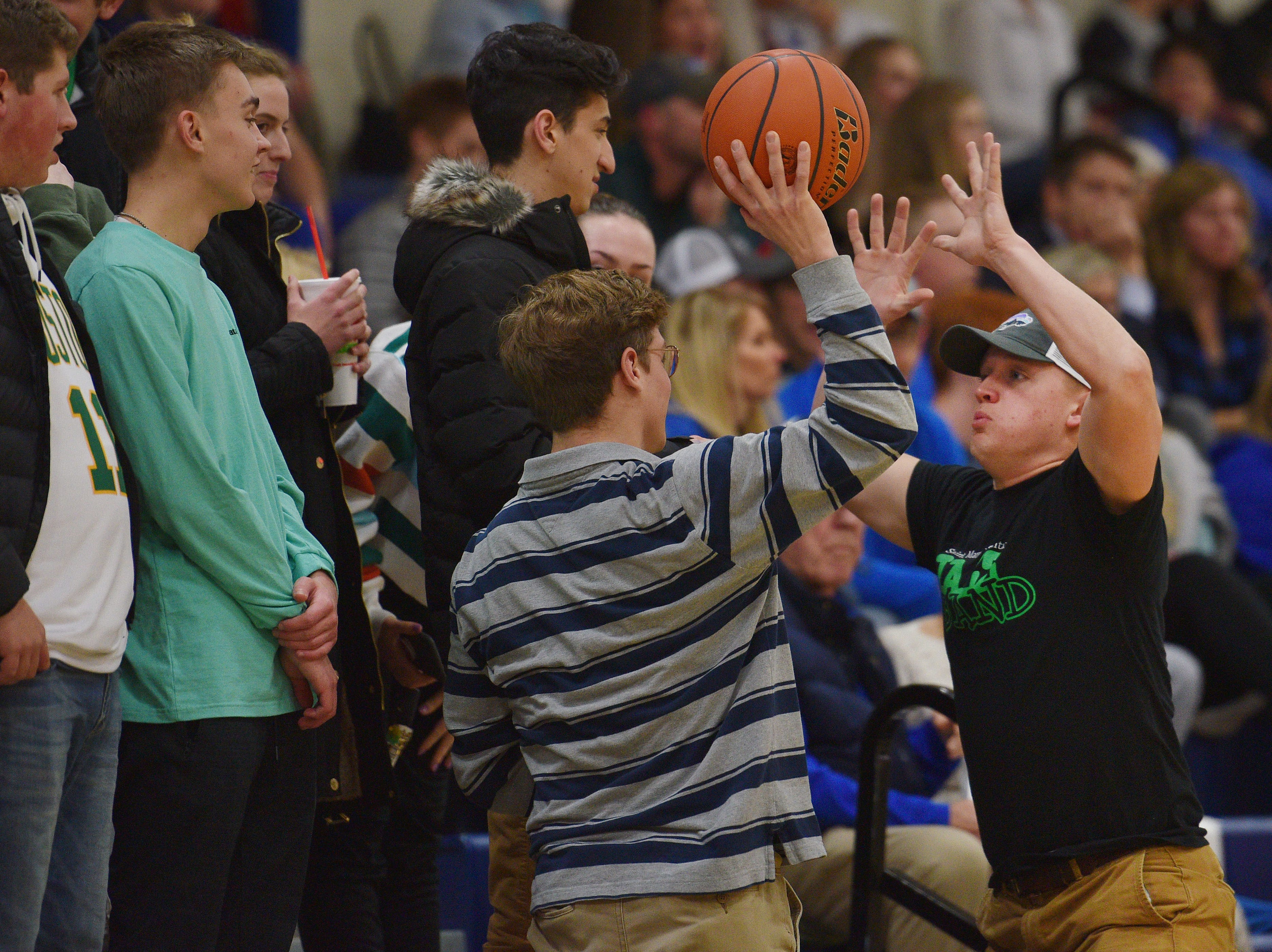 O'Gorman's student section plays with the ball once it goes out of bounds during the game against Washington Thursday, Jan. 10, at O'Gorman in Sioux Falls.