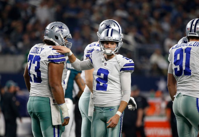 Dallas Cowboys' Joe Looney (73) and Brett Maher (2) celebrate a score in the second half of an NFL football game against the Philadelphia Eagles in Arlington, Texas, Sunday, Dec. 9, 2018. (AP Photo/Ron Jenkins)