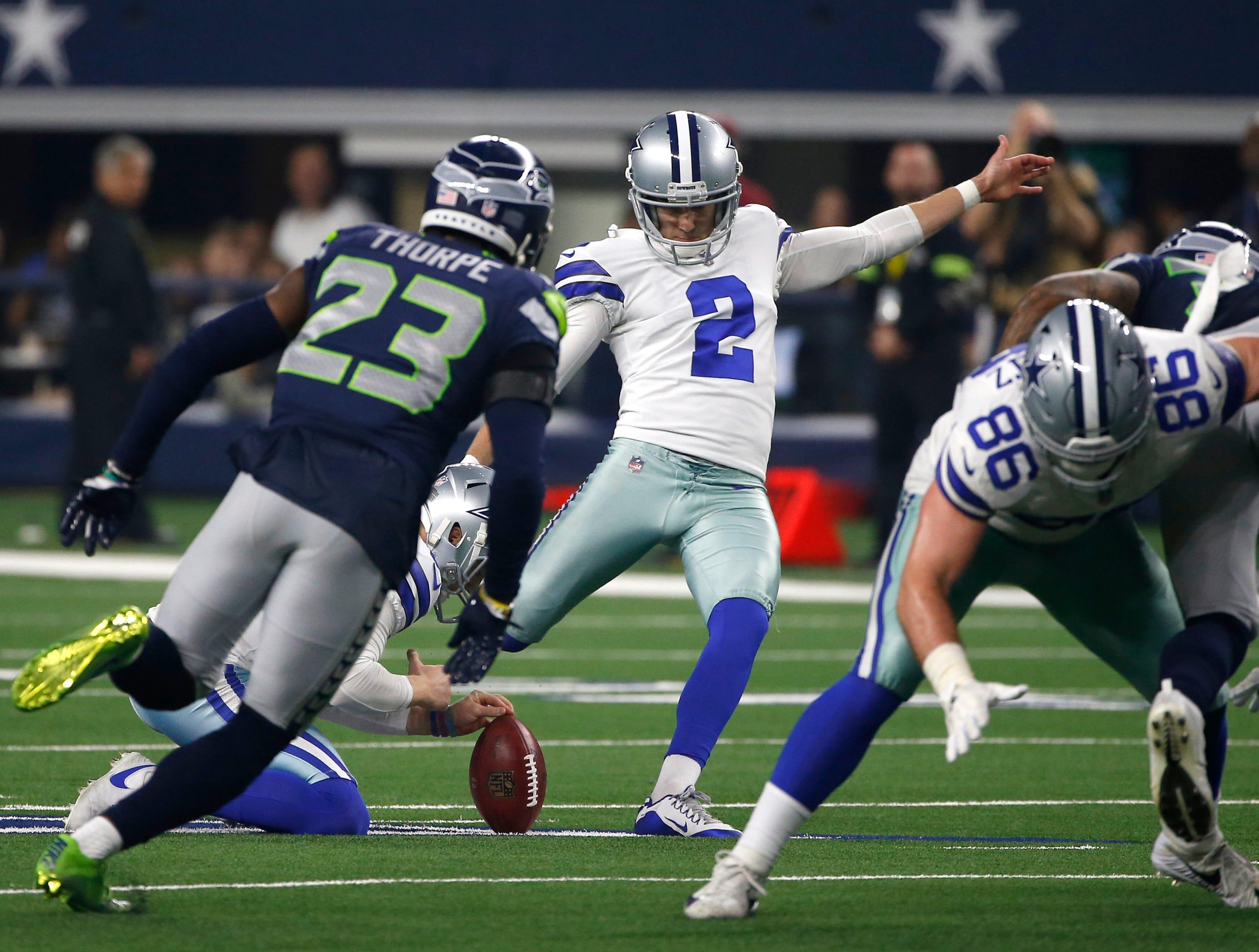Seattle Seahawks cornerback Neiko Thorpe (23) rushes as Dallas Cowboys place kicker Brett Maher (2) attempts to score during an NFC wild-card NFL football game in Arlington, Texas, Saturday, Jan. 5, 2019.(AP Photo/Ron Jenkins)