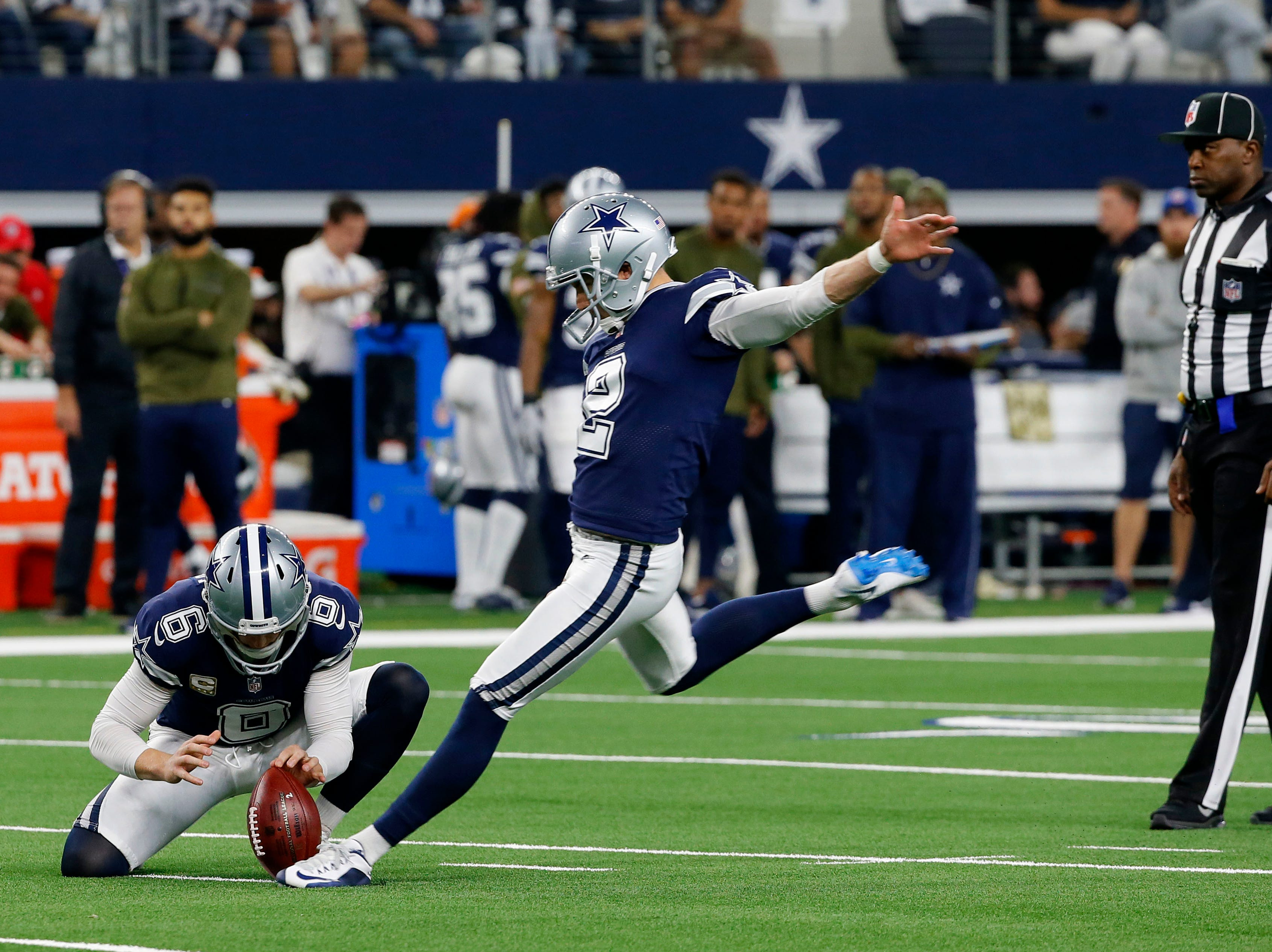 Dallas Cowboys kicker Brett Maher (2) attempts a field goal as Chris Jones (6) holds the ball during the first half of an NFL football game between the Dallas Cowboys and Tennessee Titans in Arlington, Texas, Monday, Nov. 5, 2018. The Tennessee Titans won 28-14. (AP Photo/Roger Steinman)