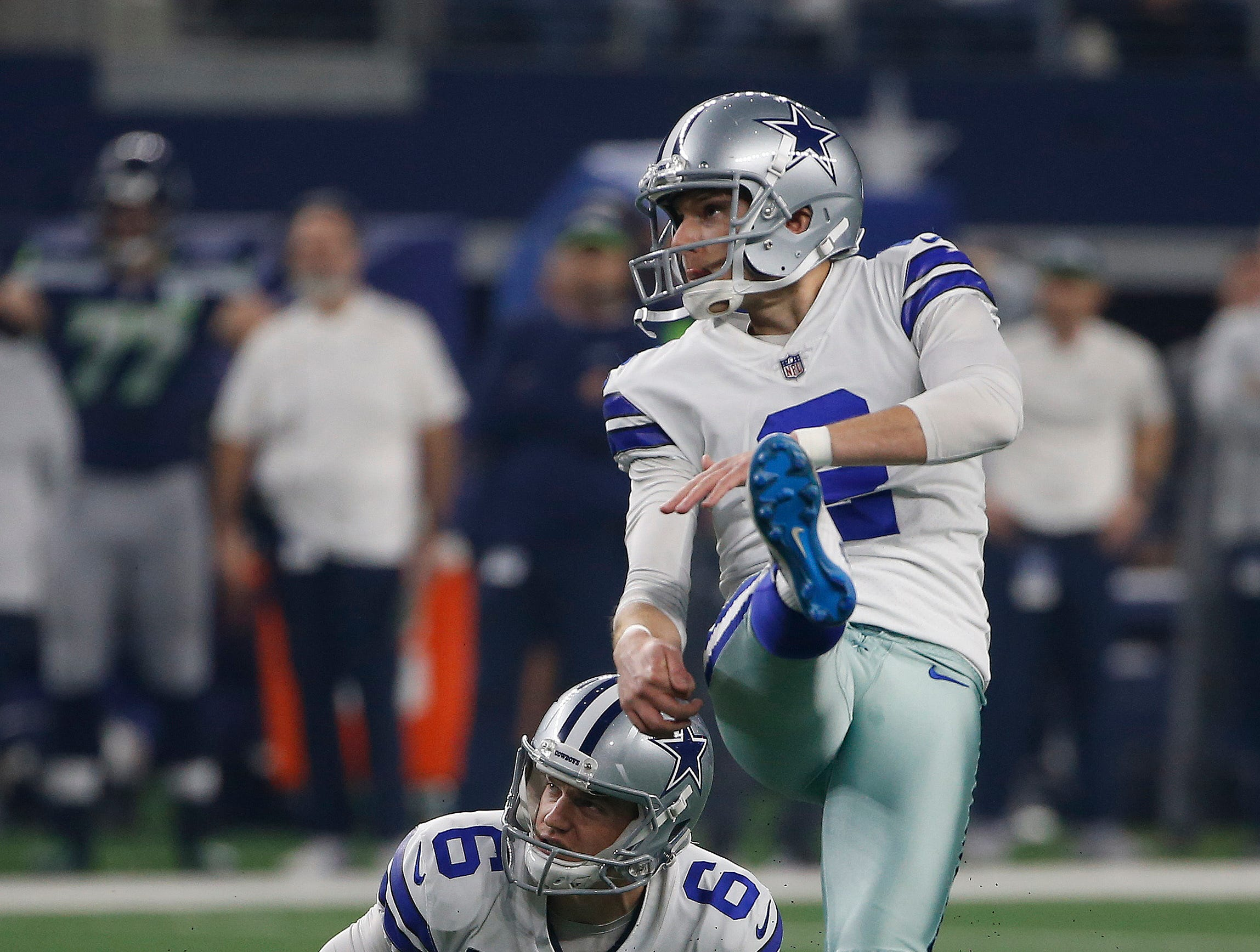 Dallas Cowboys place kicker Brett Maher (2) and punter Chris Jones (6) watch 39-yard field goal kick by Maher during the first half of the NFC wild-card NFL football game in Arlington, Texas, Saturday, Jan. 5, 2019. (AP Photo/Ron Jenkins)