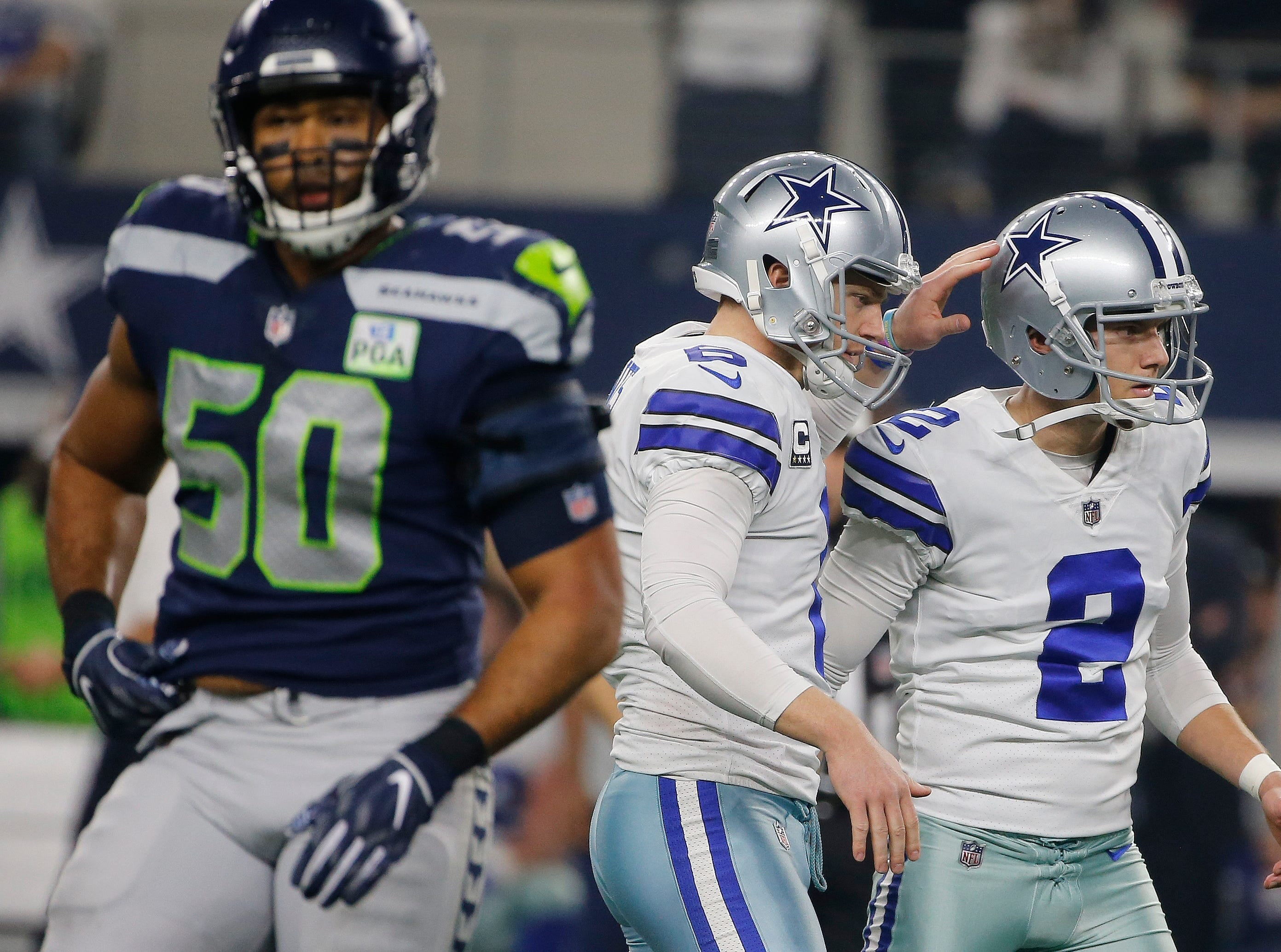 Dallas Cowboys kicker Brett Maher (2) is congratulated after he kicked a field goal against the Seattle Seahawks first half of the NFC wild-card NFL football game in Arlington, Texas, Saturday, Jan. 5, 2019. (AP Photo/Michael Ainsworth)