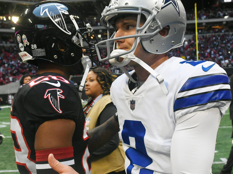 Dallas Cowboys kicker Brett Maher (2) speaks with Atlanta Falcons defensive back Justin Bethel (28) after an NFL football game, Sunday, Nov. 18, 2018, in Atlanta. The Dallas Cowboys won 22-19. (AP Photo/Danny Karnik)