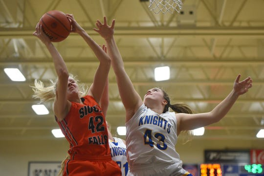 Washington's Sydni Schetnan attempts to gain control of the ball against O'Gorman's Courtney Baruth during the game Thursday, Jan. 10, at O'Gorman in Sioux Falls.