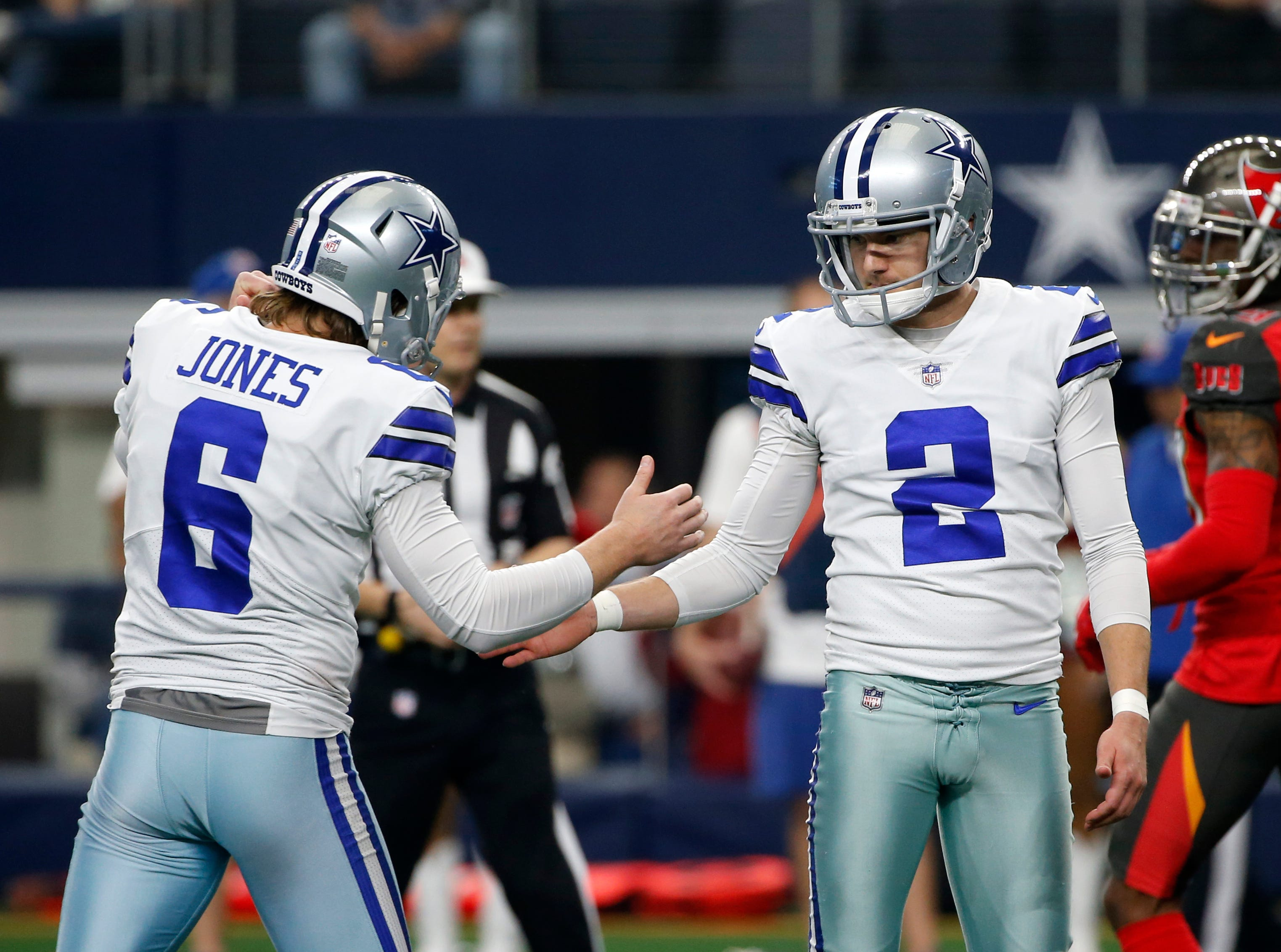 Dallas Cowboys' Chris Jones (6) and Brett Maher (2) celebrate a score during an NFL football game against the Tampa Bay Buccaneers on Sunday, Dec. 23, 2018, in Arlington, Texas. (AP Photo/Michael Ainsworth)