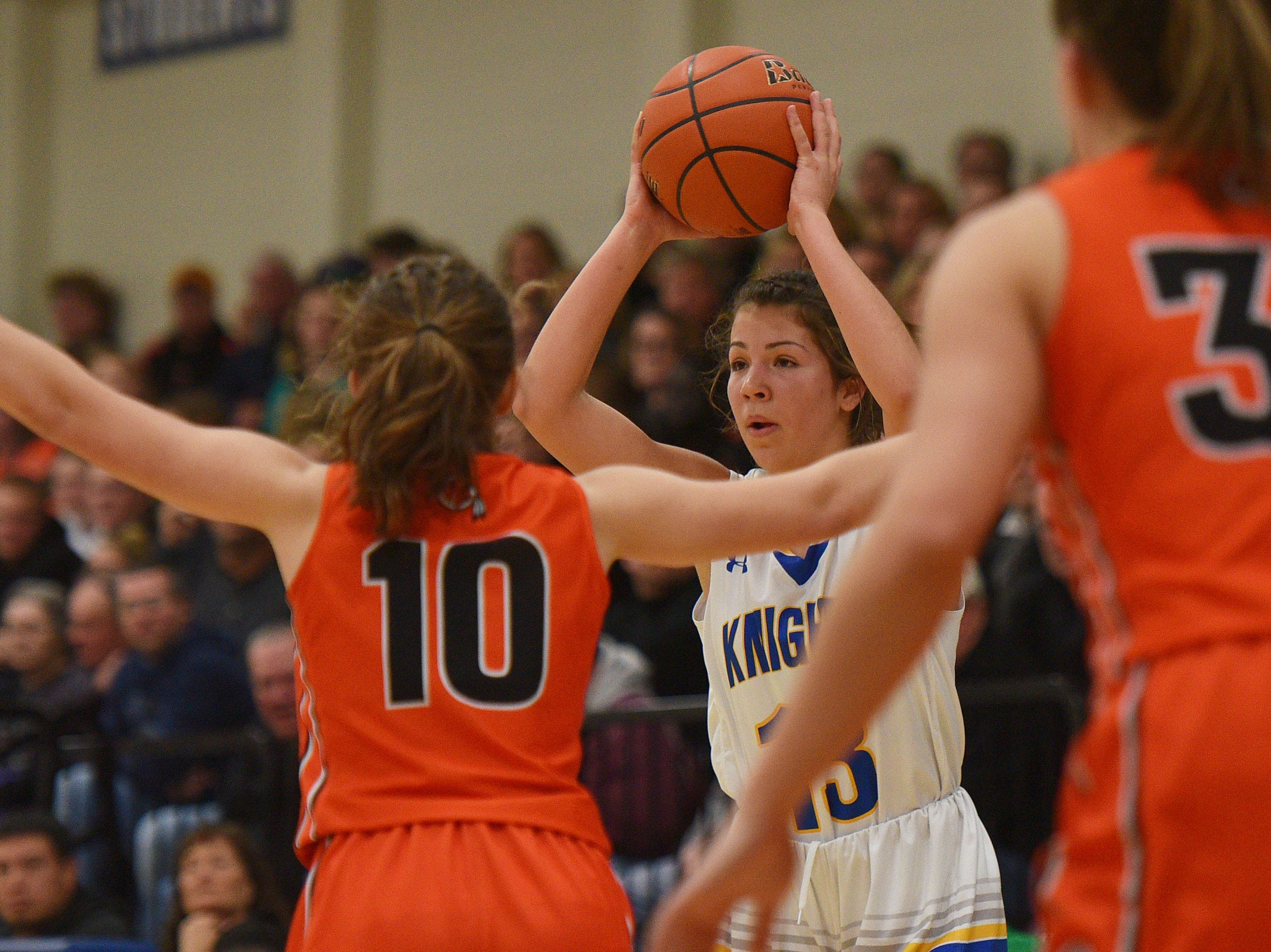 O'Gorman's Isabelle Moore goes against Washington defense during the game Thursday, Jan. 10, at O'Gorman in Sioux Falls.