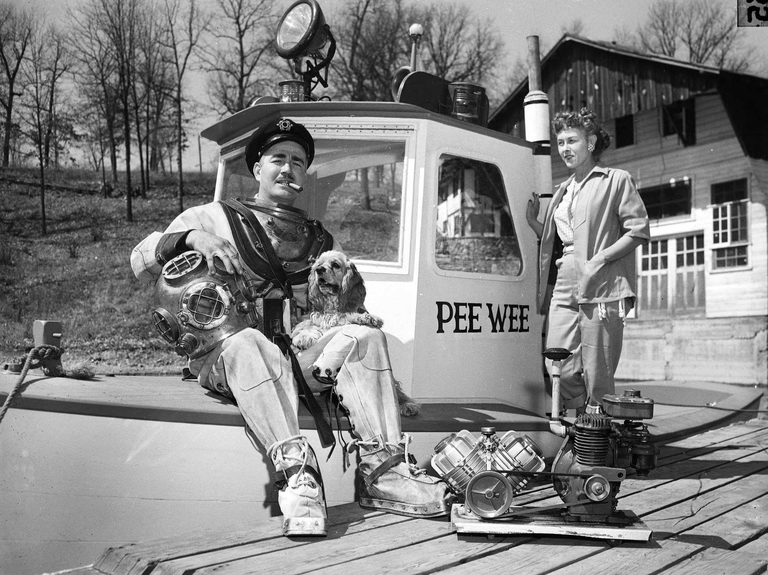 The boat named PeeWee with an unidentified man in diving gear, a woman, and a dog at the Arrowhead Yacht Club in 1955.