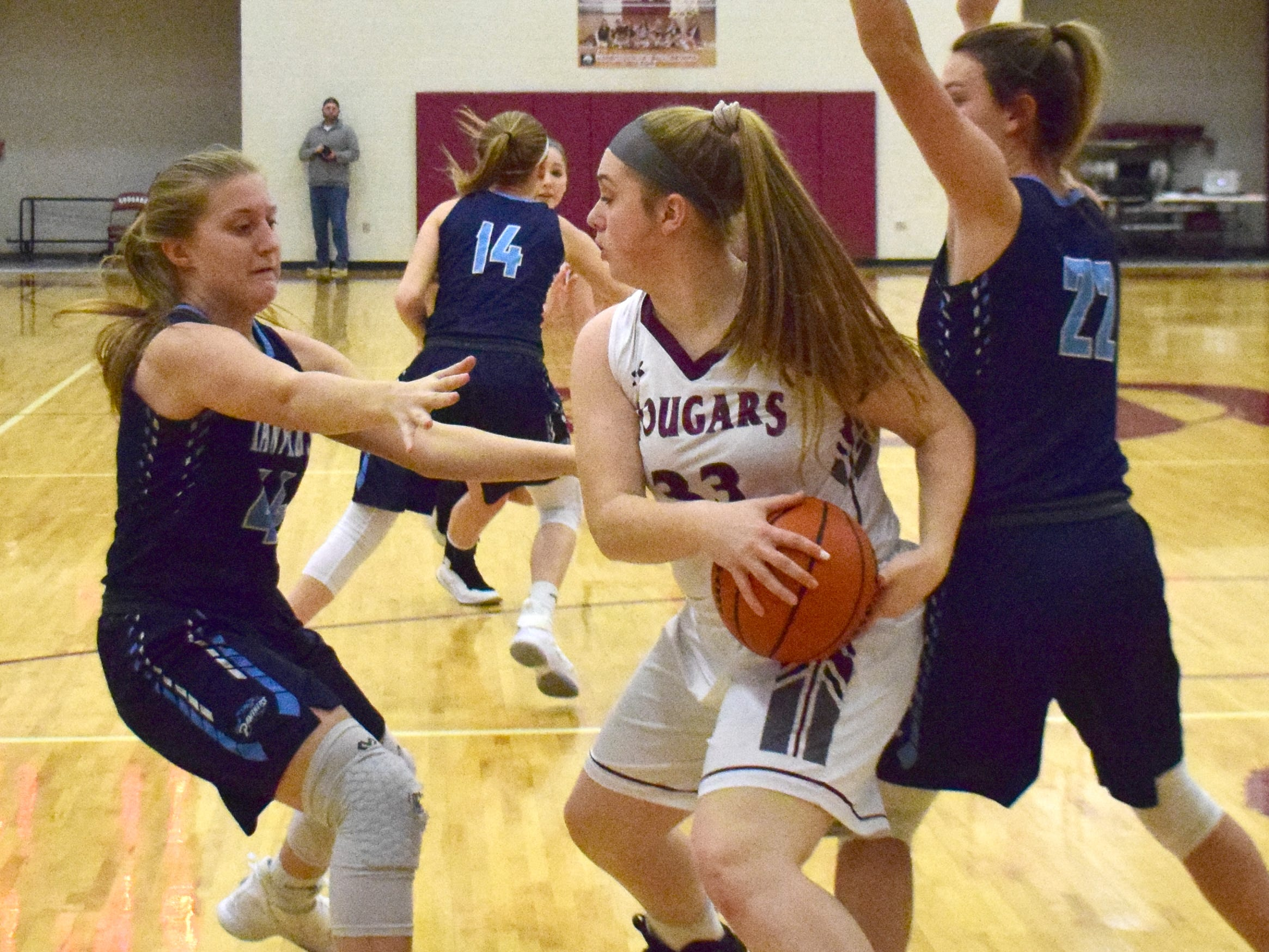 Stuarts Draft's Alexis Bridge is hemmed in by. pair of Page County defenders during the first half of their Shenandoah District girls basketball game on Thursday, Jan. 10, 2019, at Stuarts Draft High School in Stuarts Draft, Va.
