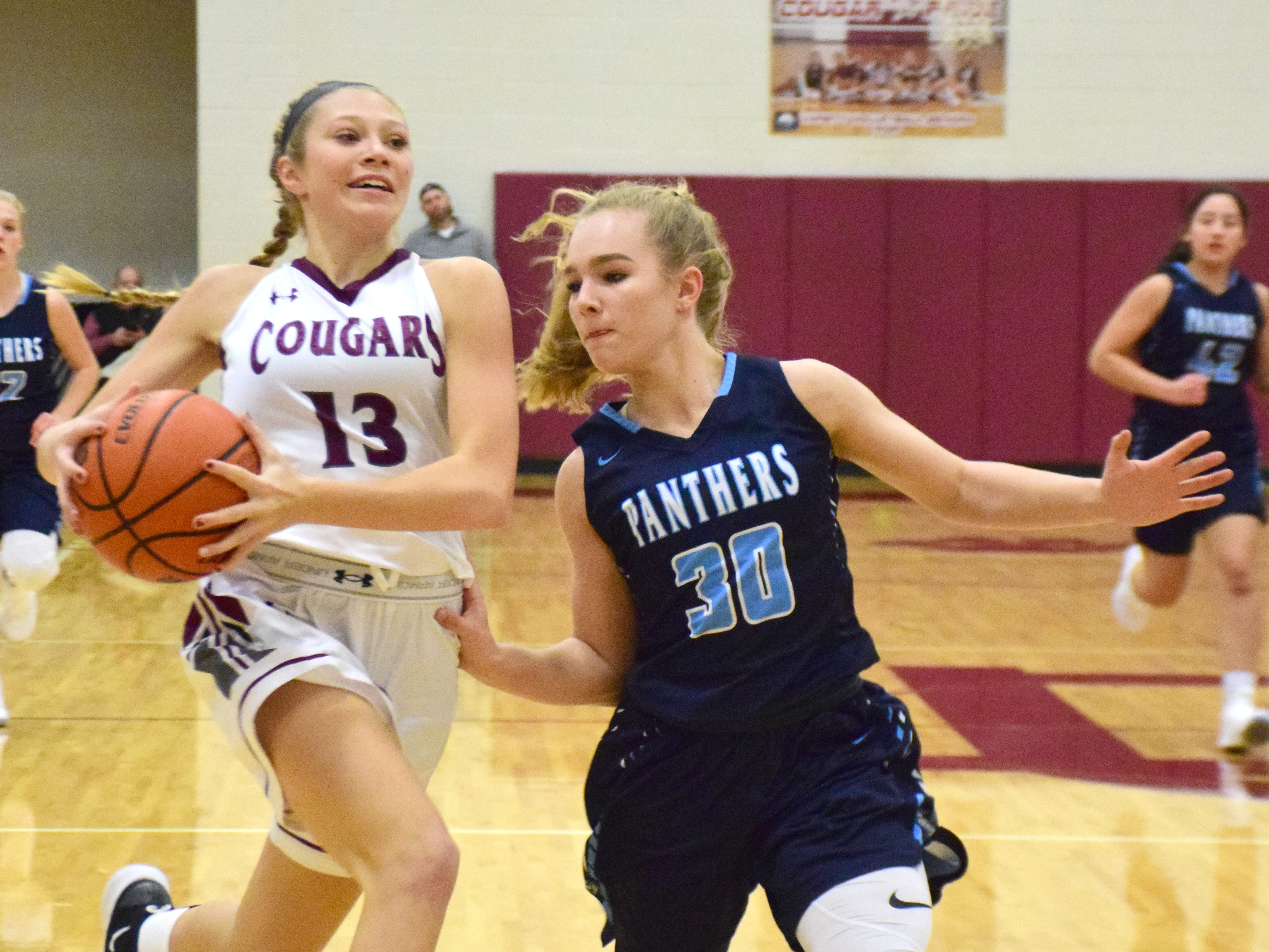 Stuarts Draft's Leah Wood drives to the basket against Page County's Caris Lucas during the first half of their Shenandoah District girls basketball game on Thursday, Jan. 10, 2019, at Stuarts Draft High School in Stuarts Draft, Va.