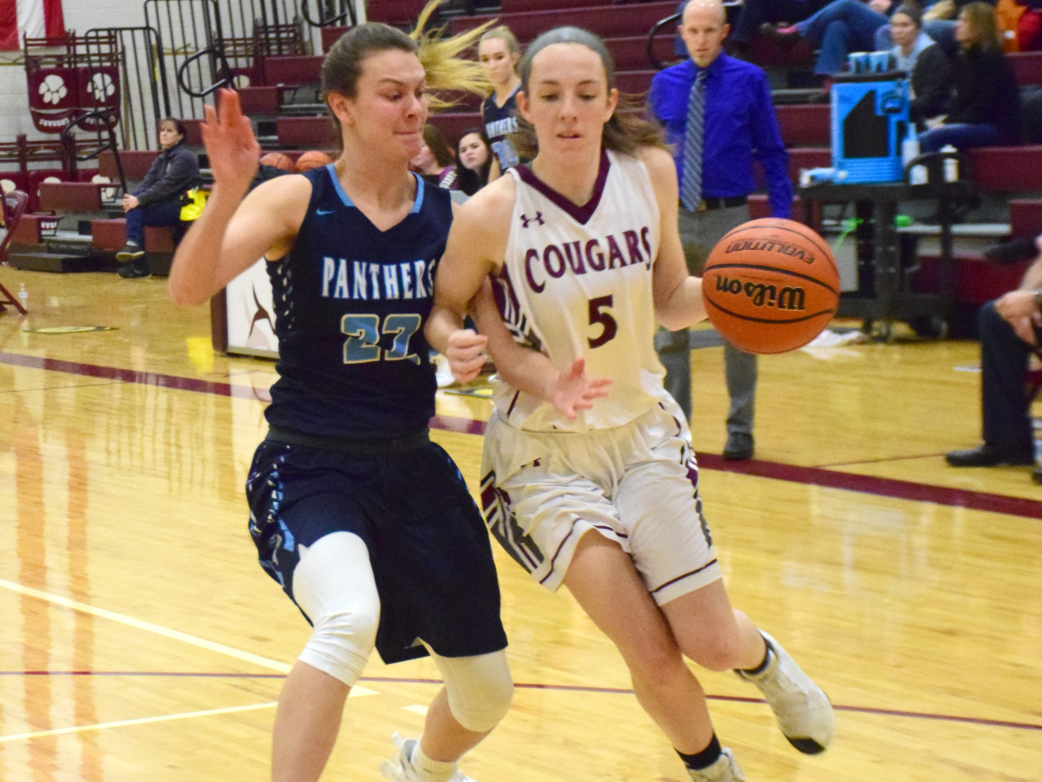 Stuarts Draft's Lyndsay Harris is pressured by Page County's Lyndsey Knowles during the first half of their Shenandoah District girls basketball game on Thursday, Jan. 10, 2019, at Stuarts Draft High School in Stuarts Draft, Va.