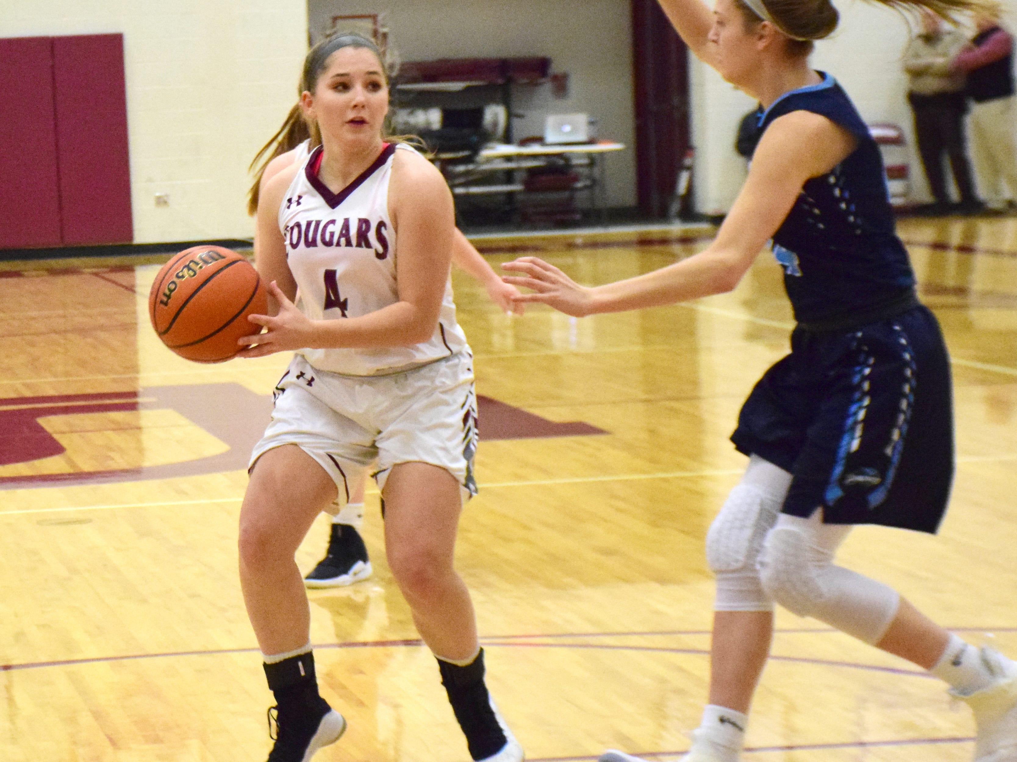 Stuarts Draft's Maggie Sorrells looks to pass in the lane against Page County during the first half of their Shenandoah District girls basketball game on Thursday, Jan. 10, 2019, at Stuarts Draft High School in Stuarts Draft, Va.