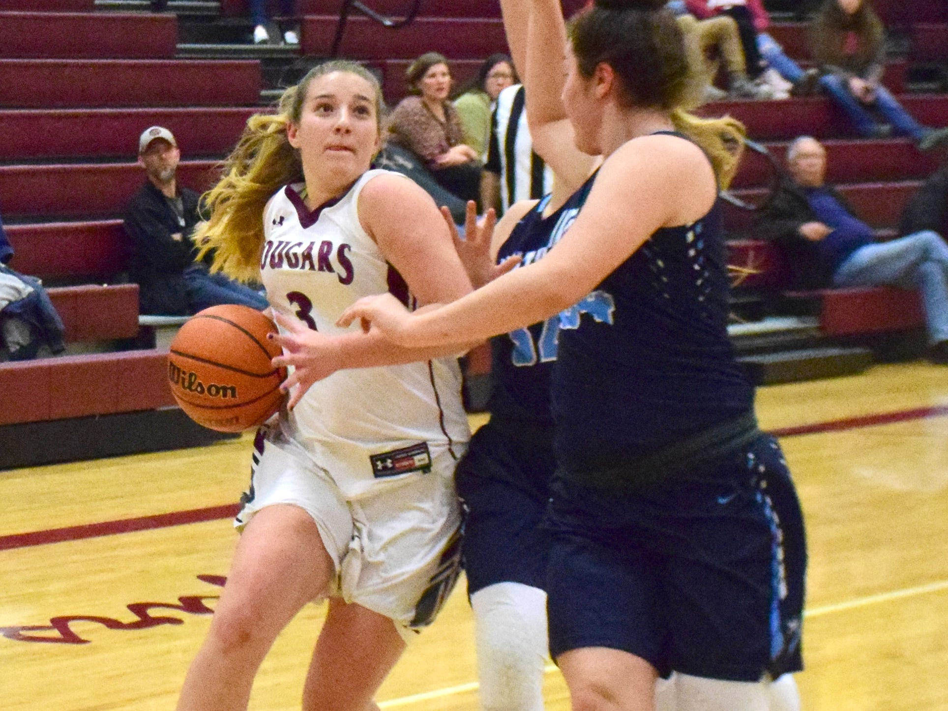 Stuarts Draft's McKinley Fitzgerald goes up against Page County defenders during the first half of their Shenandoah District girls basketball game on Thursday, Jan. 10, 2019, at Stuarts Draft High School in Stuarts Draft, Va.