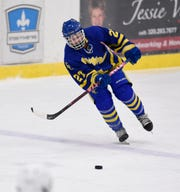 Cathedral's Blake Perbix passes the puck during the Thursday, Jan. 10, game at Bernicks Arena in Sartell.