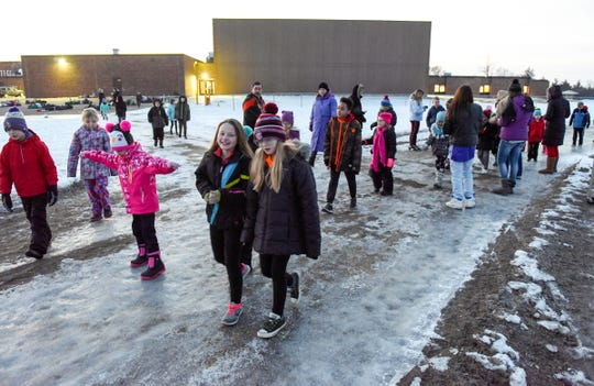 Students at Clearview Elementary School take their morning walk before classes Friday, Jan. 11, in Clear Lake.