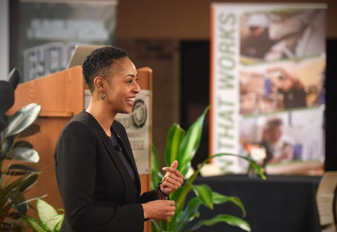 St. Cloud Technical and Community College President Annesa Cheek smiles during her presentation to community members Thursday, Jan.10, in St. Cloud.