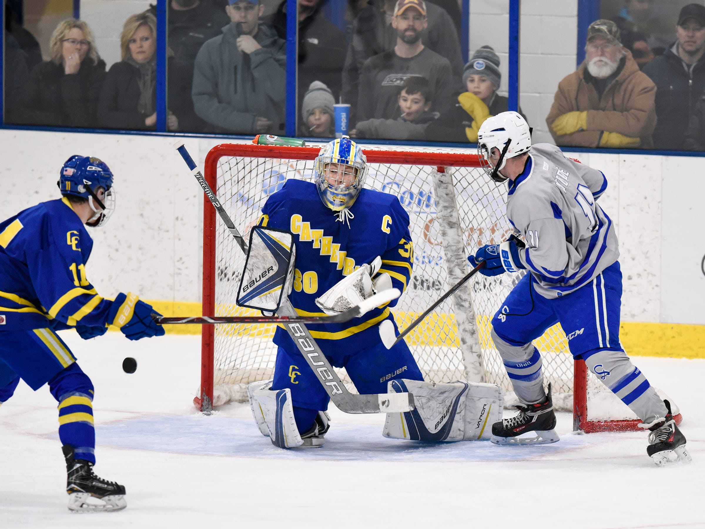 The puck bounces wide past Cathedral goaltender Noah Amundson during the Thursday, Jan. 10, game at Bernicks Arena in Sartell.