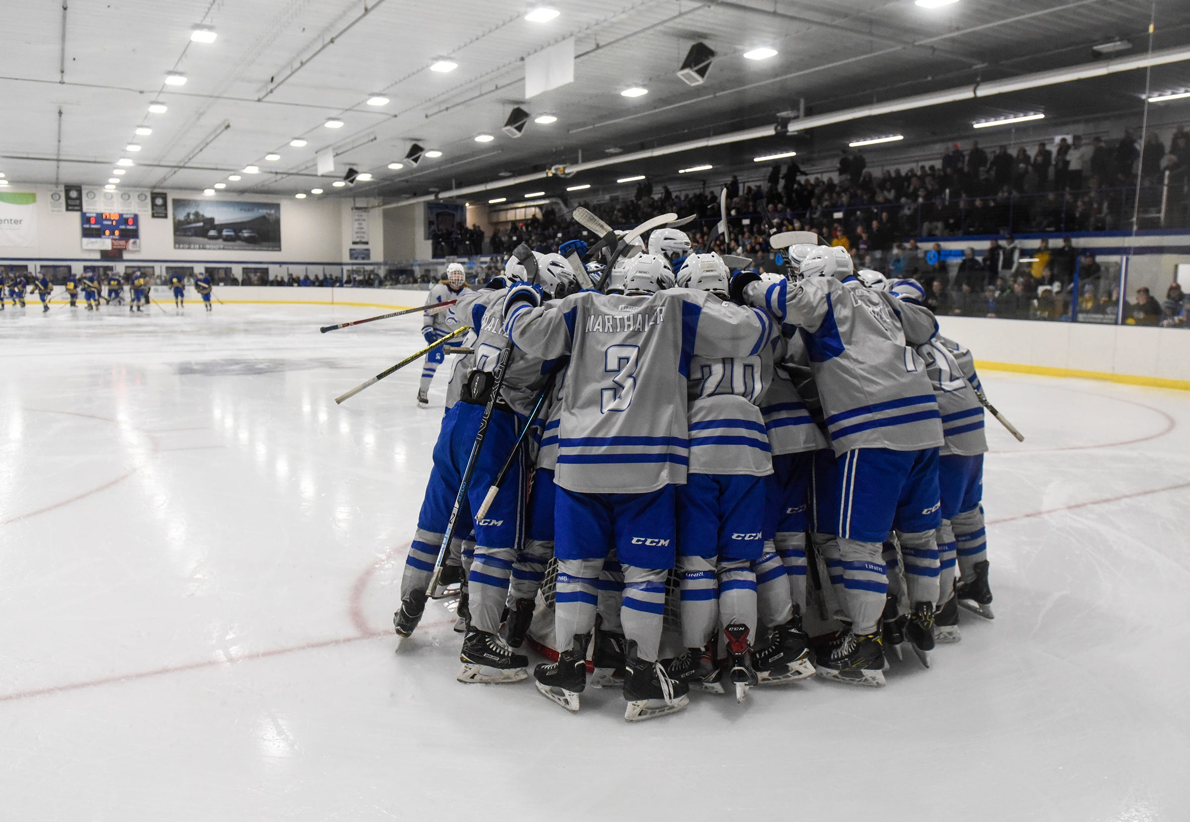 Sartell players gather around their goal at the start of the game.