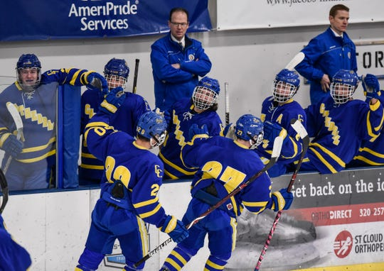 Cathedral players celebrate a first period goal during the Thursday, Jan. 10, game against Sartell at Bernicks Arena in Sartell.