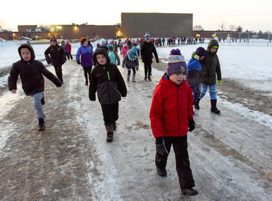 Students at Clearview Elementary School take their morning walk before classes start Friday, Jan. 11, in Clear Lake.