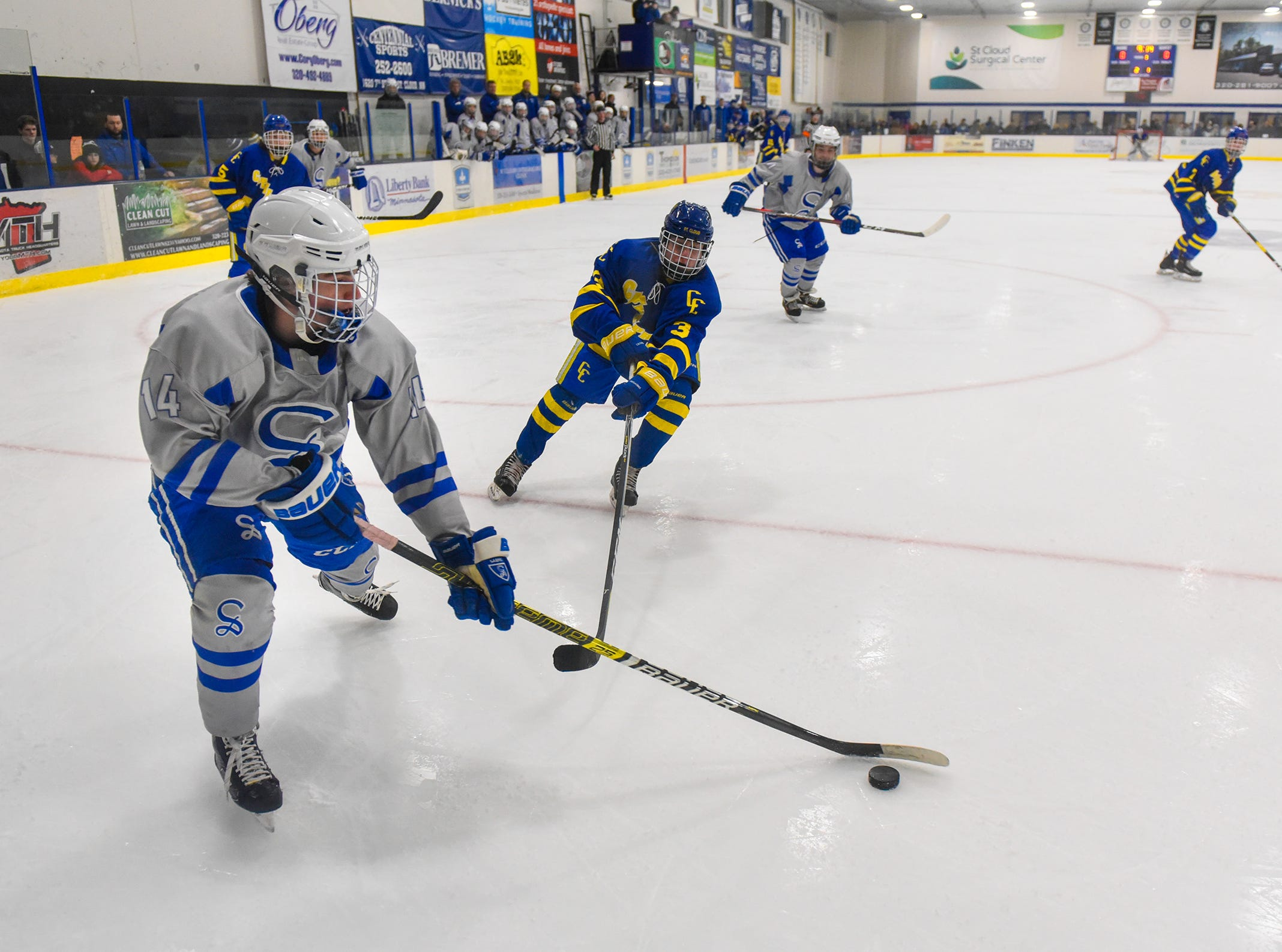Sartell's Austin Adelman controls the puck during the Thursday, Jan. 10, game against Cathedral at Bernicks Arena in Sartell.