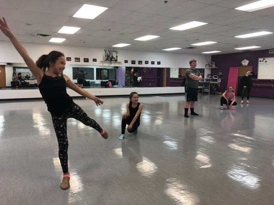 Dancers rehearse for the annual Decades of Dance performance.