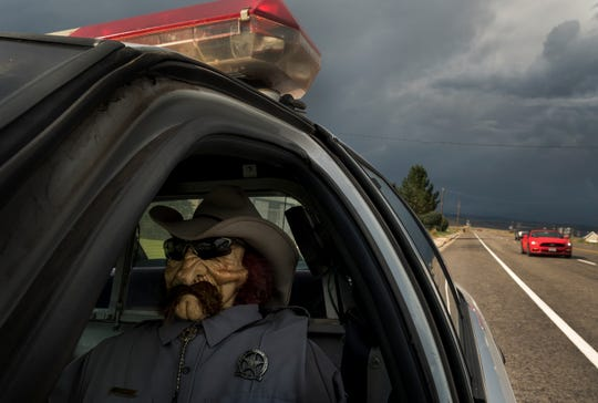 Parked on the shoulder of Highway 24, Wayne County Sheriff's officer Parker Doolittle deters would be speeders in the small town of Loa, Utah, September 13, 2017. (Francisco Kjolseth/The Salt Lake Tribune via AP)
