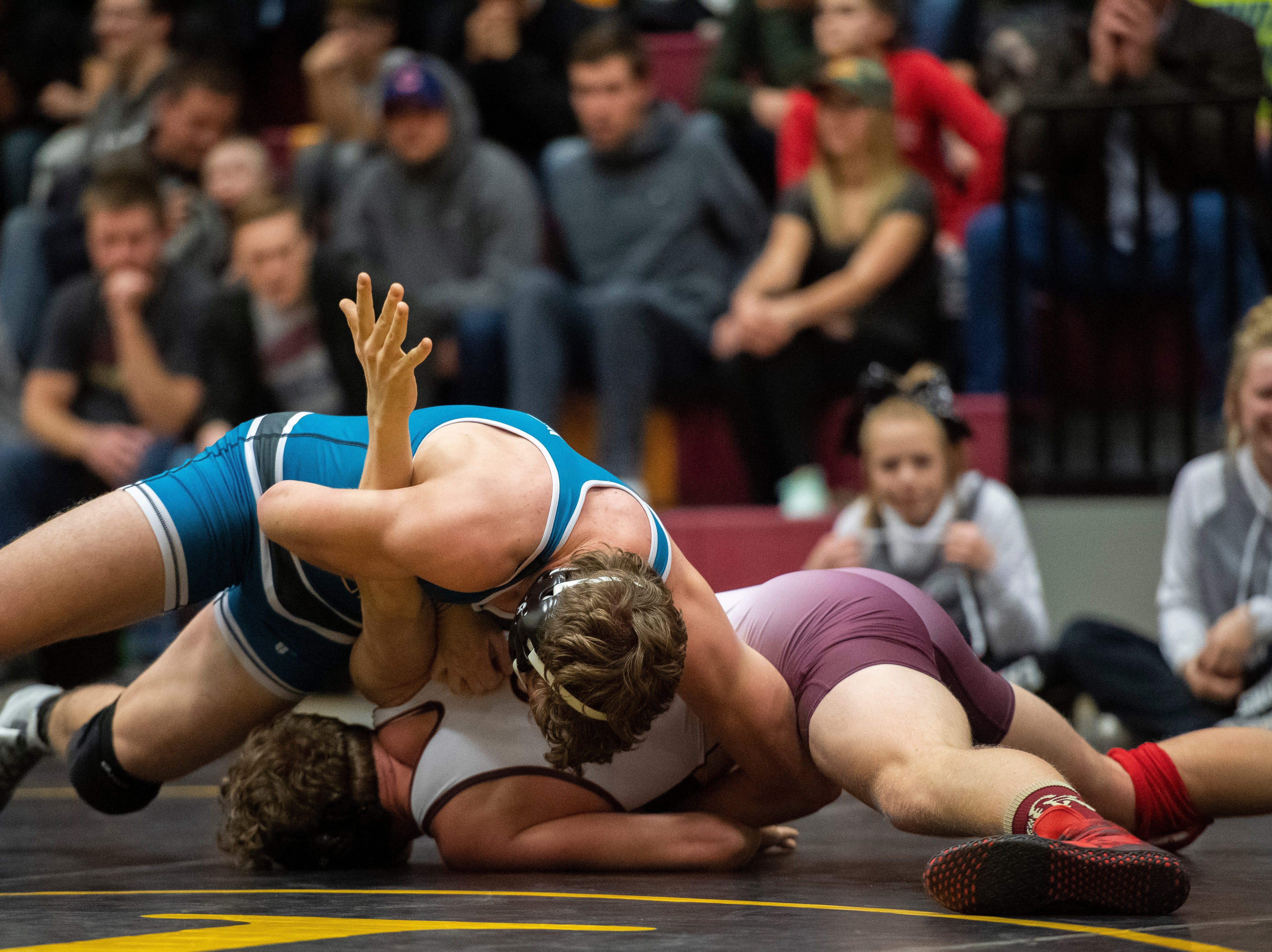 Cedar High School wrestlers battle Canyon View at CHS Thursday, January 10, 2019. Canyon View won, 45-33.