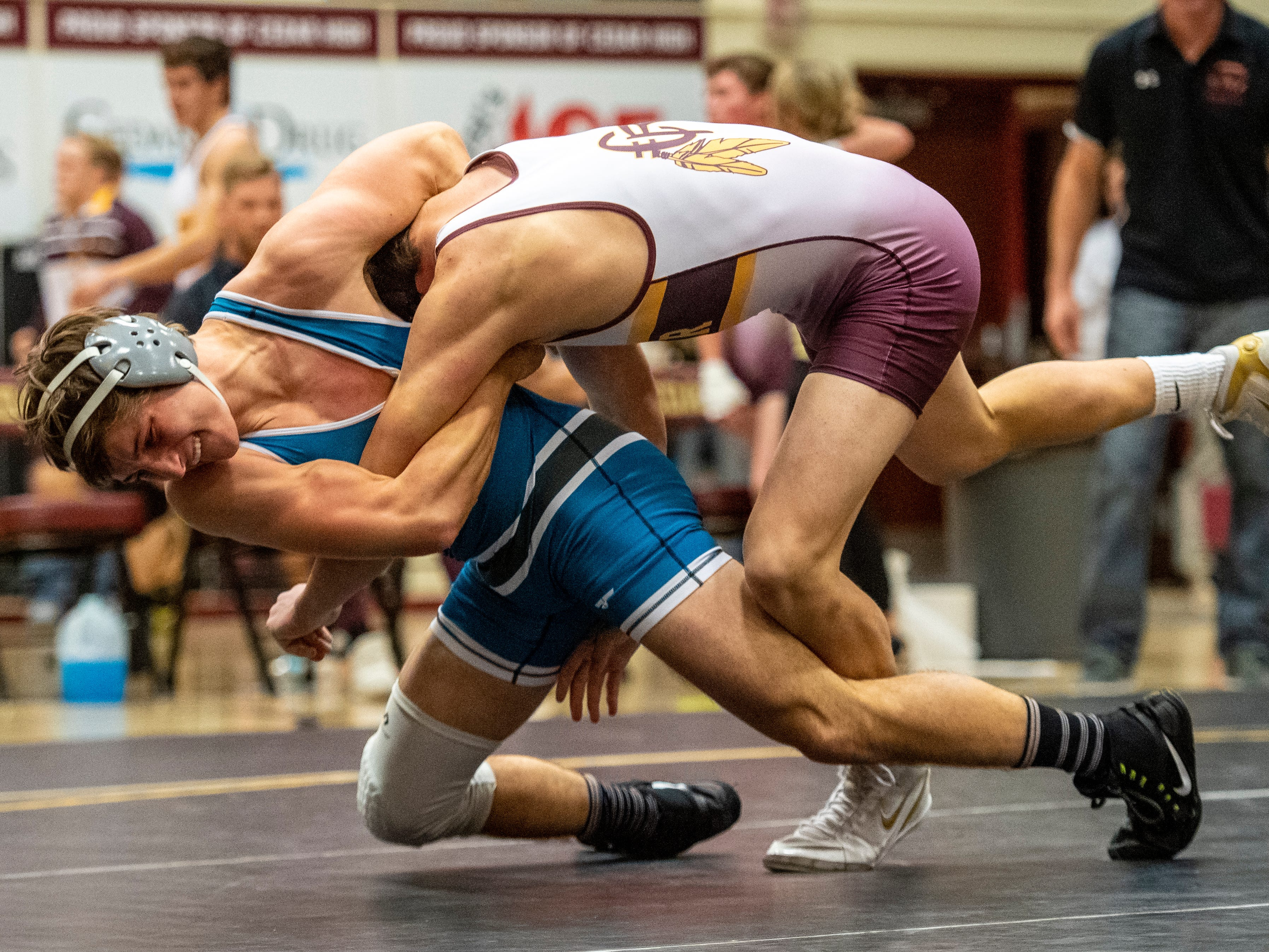 Canyon View High School's Brady Lowry brings his opponent to the mat at Cedar High School Thursday, January 10, 2019. Canyon View won, 45-33.