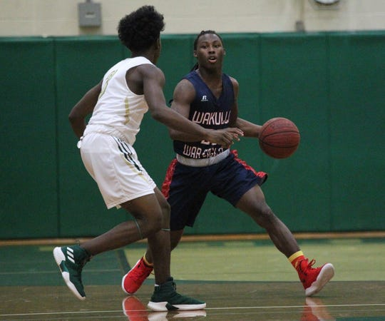 Wakulla's Jaylon Worsham dribbles up the court during a game at Lincoln on Jan. 10, 2019.