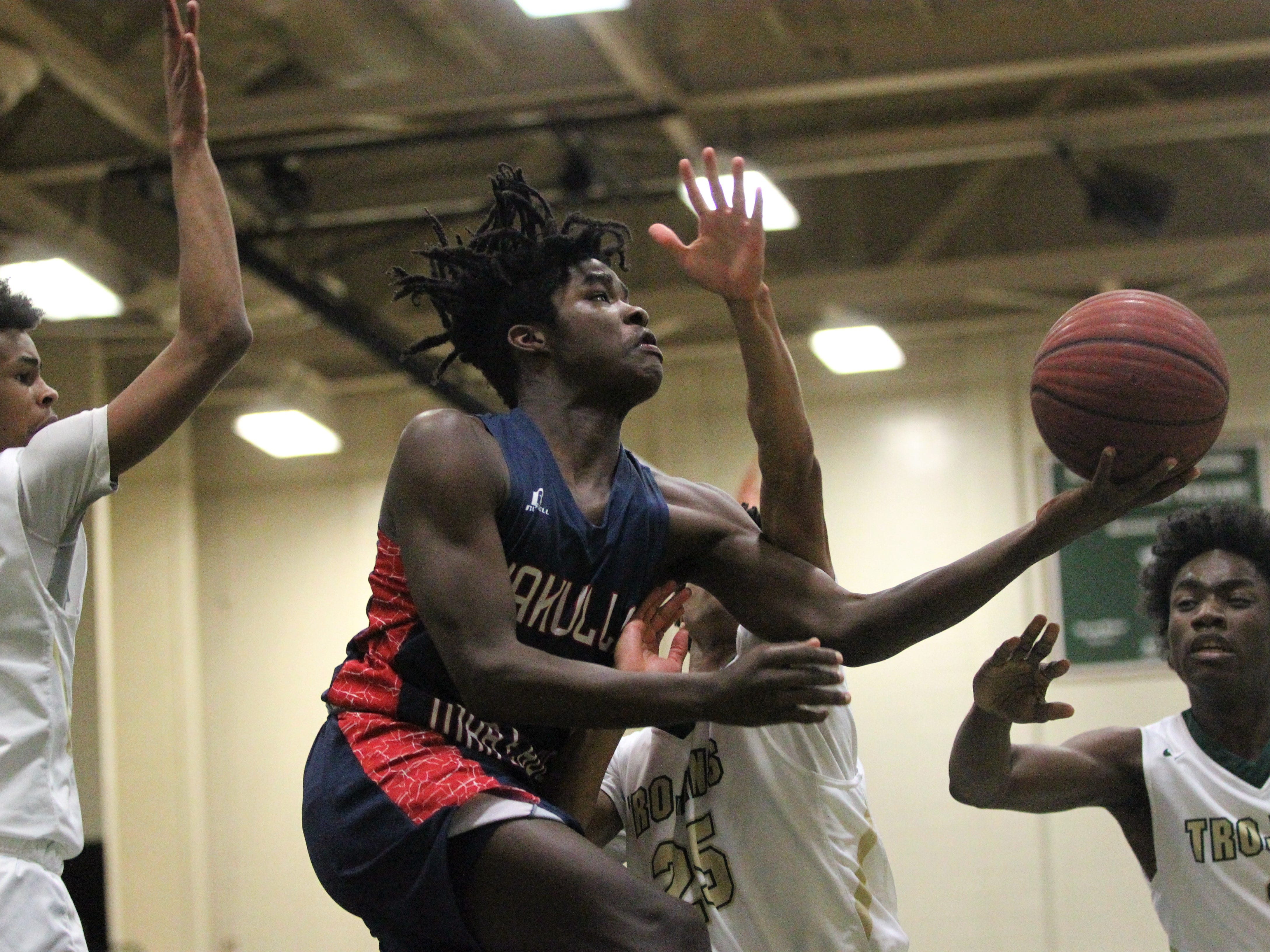 Wakulla's Desmond Greene tries a scoop layup under Lincoln defenders during a game on Jan. 10, 2019.