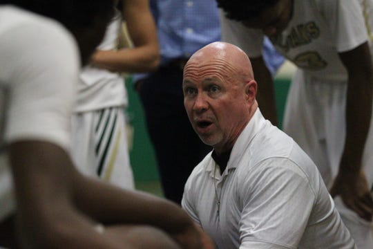Lincoln boys basketball coach Matt Anderson talks to his team in a timeout during a home game against Wakulla on Jan. 10, 2019.