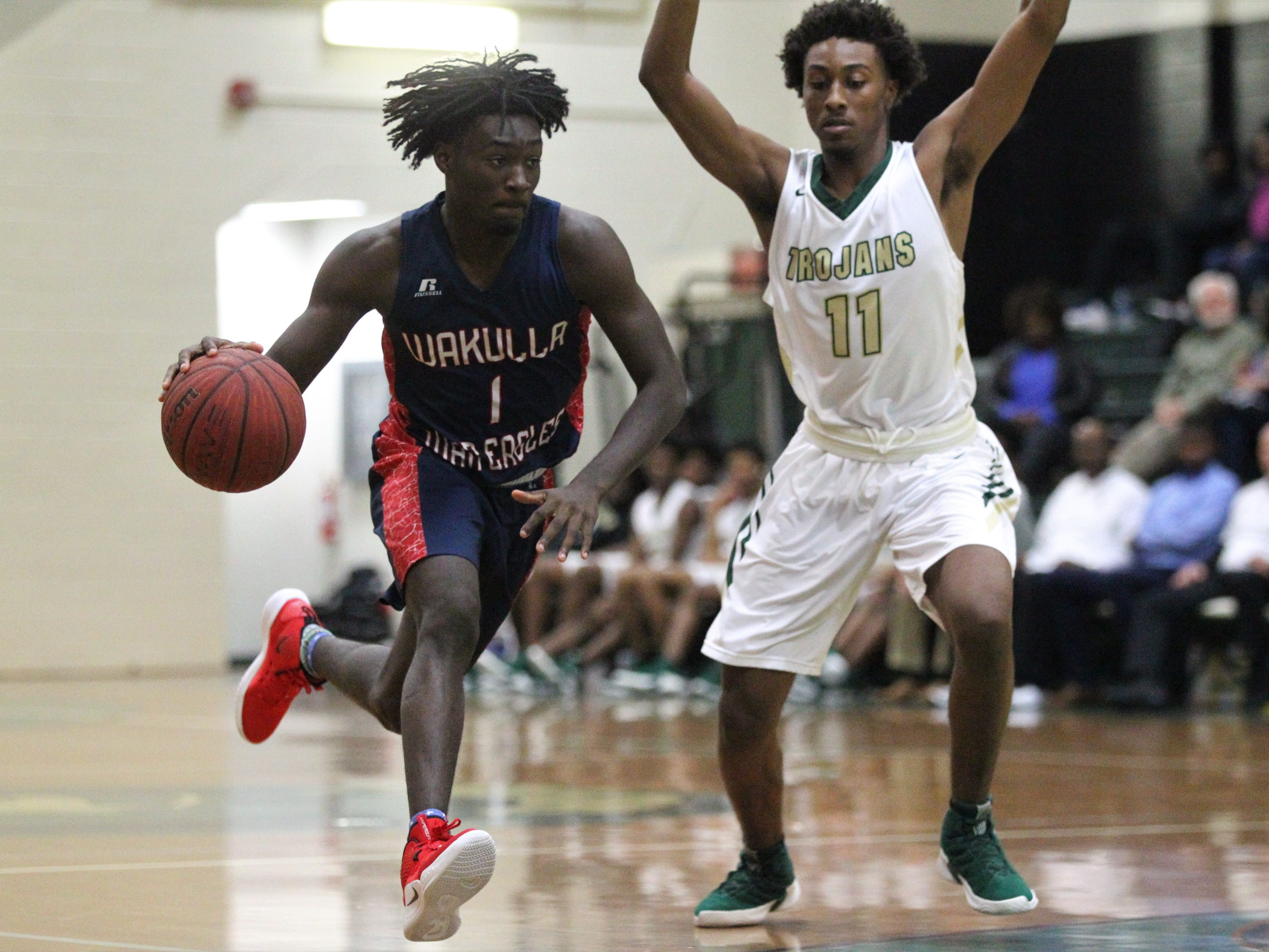 Wakulla's Quez Allen brings the ball up the court as Lincoln's Jaleel Howard guards during a game at Lincoln on Jan. 10, 2019.