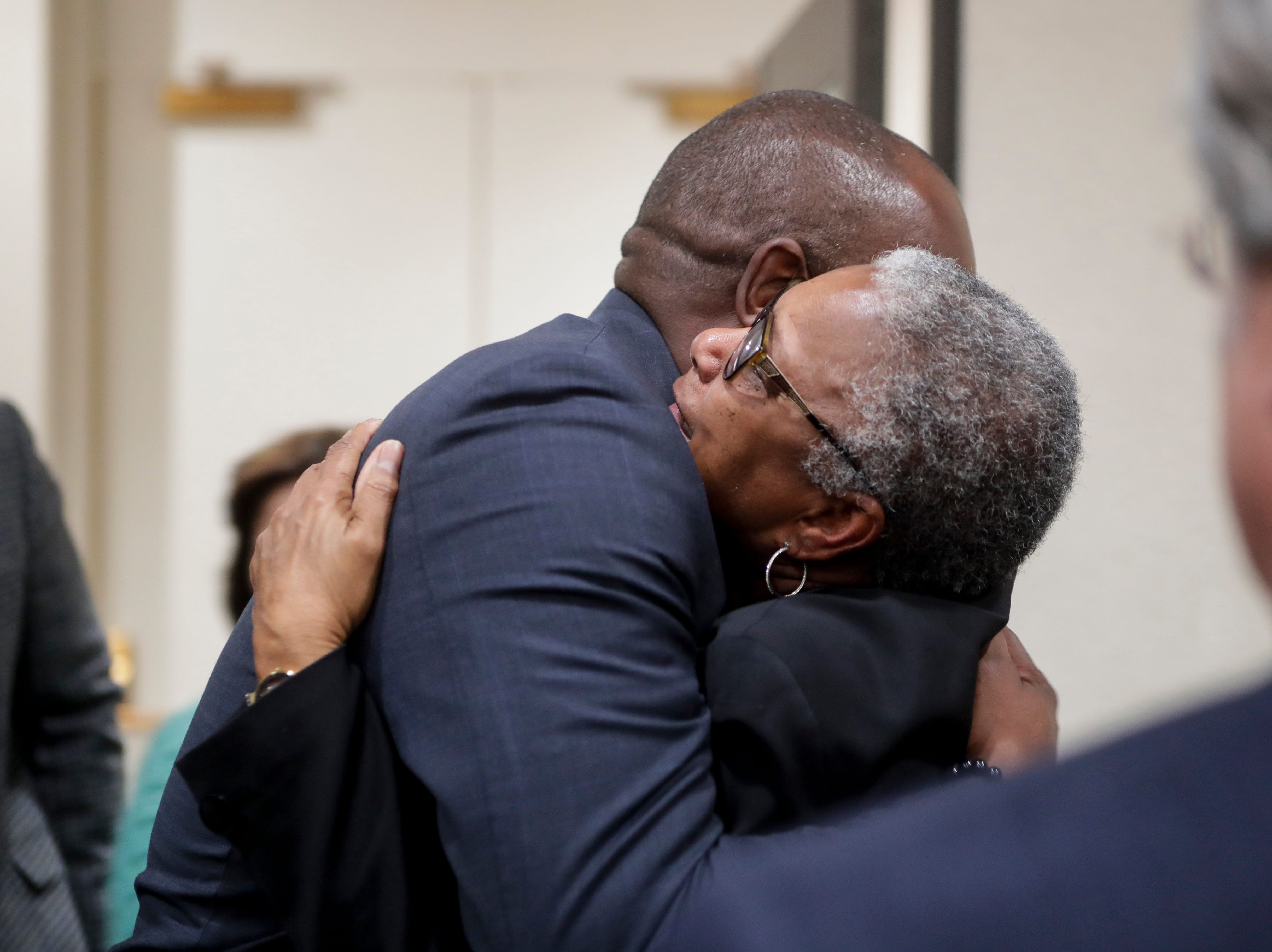 Carol (Greenlee) Crawley, daughter of Charles Greenlee, one of the four men in the Groveland Four, hugs Rep. Bobby Dubose, after her father was pardoned by Gov. Ron DeSantis and his cabinet during a clemency board hearing Friday, Jan. 11, 2019.