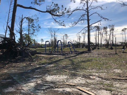 Damaged playground equipment remains twisted in a park in Panama City.