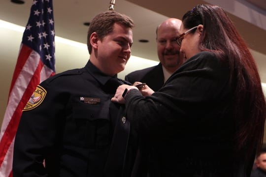 Guy Ward's badge is pinned as he joins the Tallahassee Police Department Friday