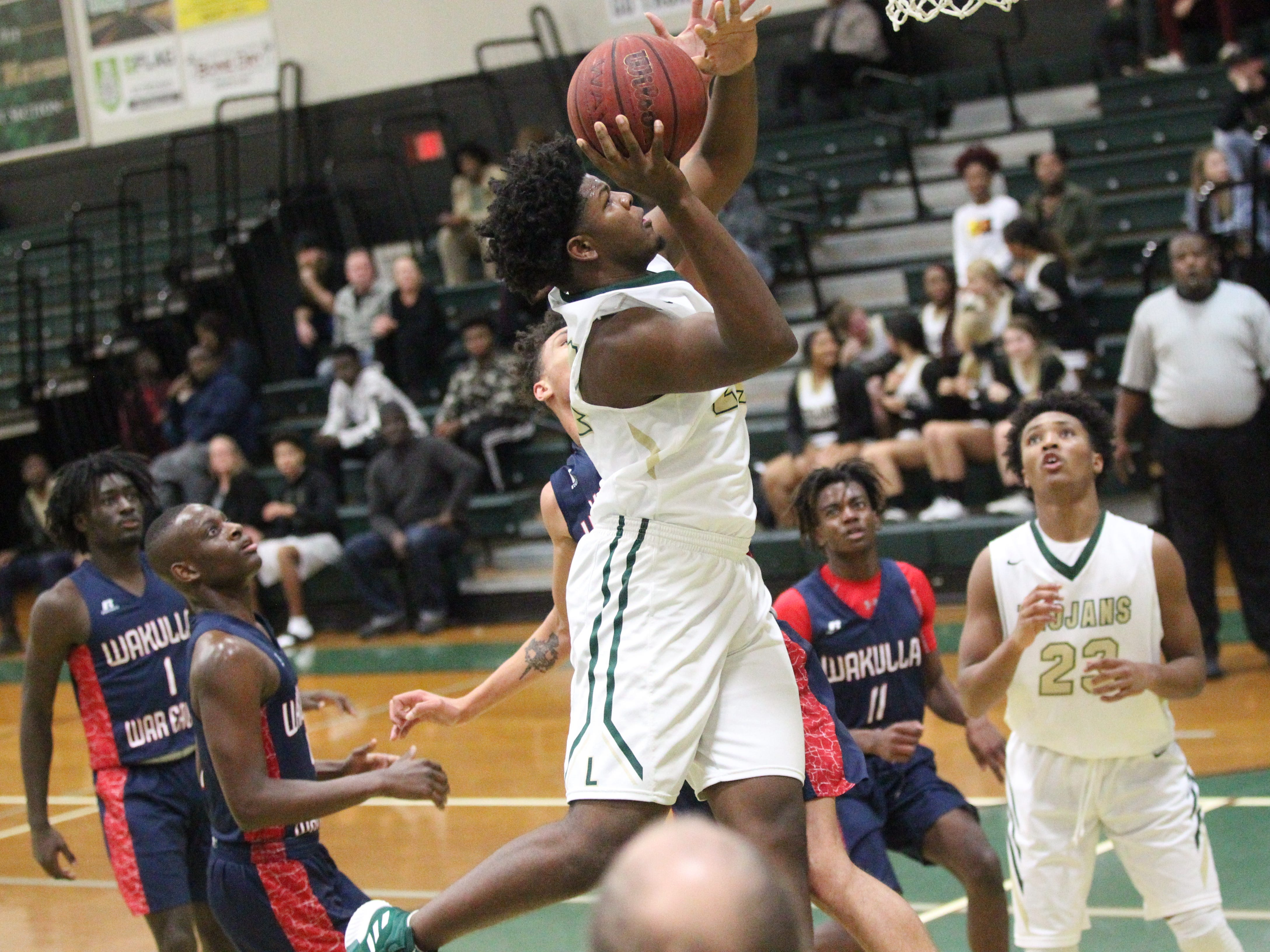 Lincoln''s Terence Card hangs in the air for a layup during a home game against Wakulla on Jan. 10, 2019.