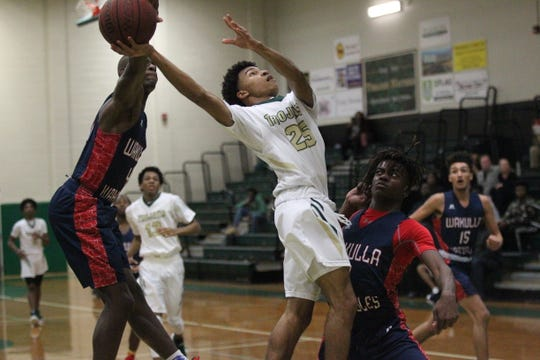 Wakulla's Trevon Hale blocks the layup attempt of Lincoln's Rajauhn Sancho during a game at Lincoln on Jan. 10, 2019.