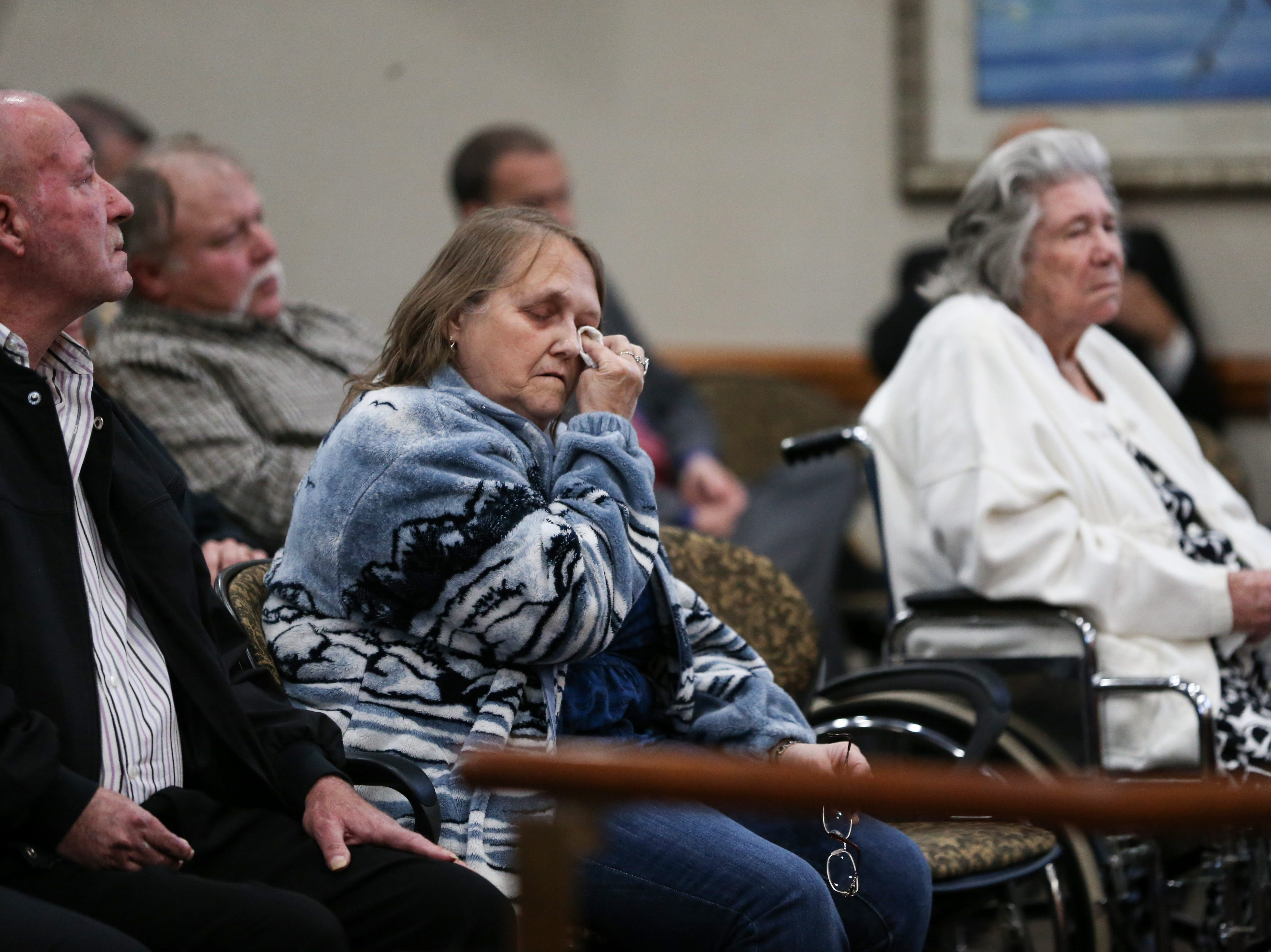 Charlene Padgett, daughter-in-law of the Groveland Four accuser Norma Padgett, right, wipes tears during a clemency board hearing where the Groveland Four were pardoned Friday, Jan. 11, 2019.