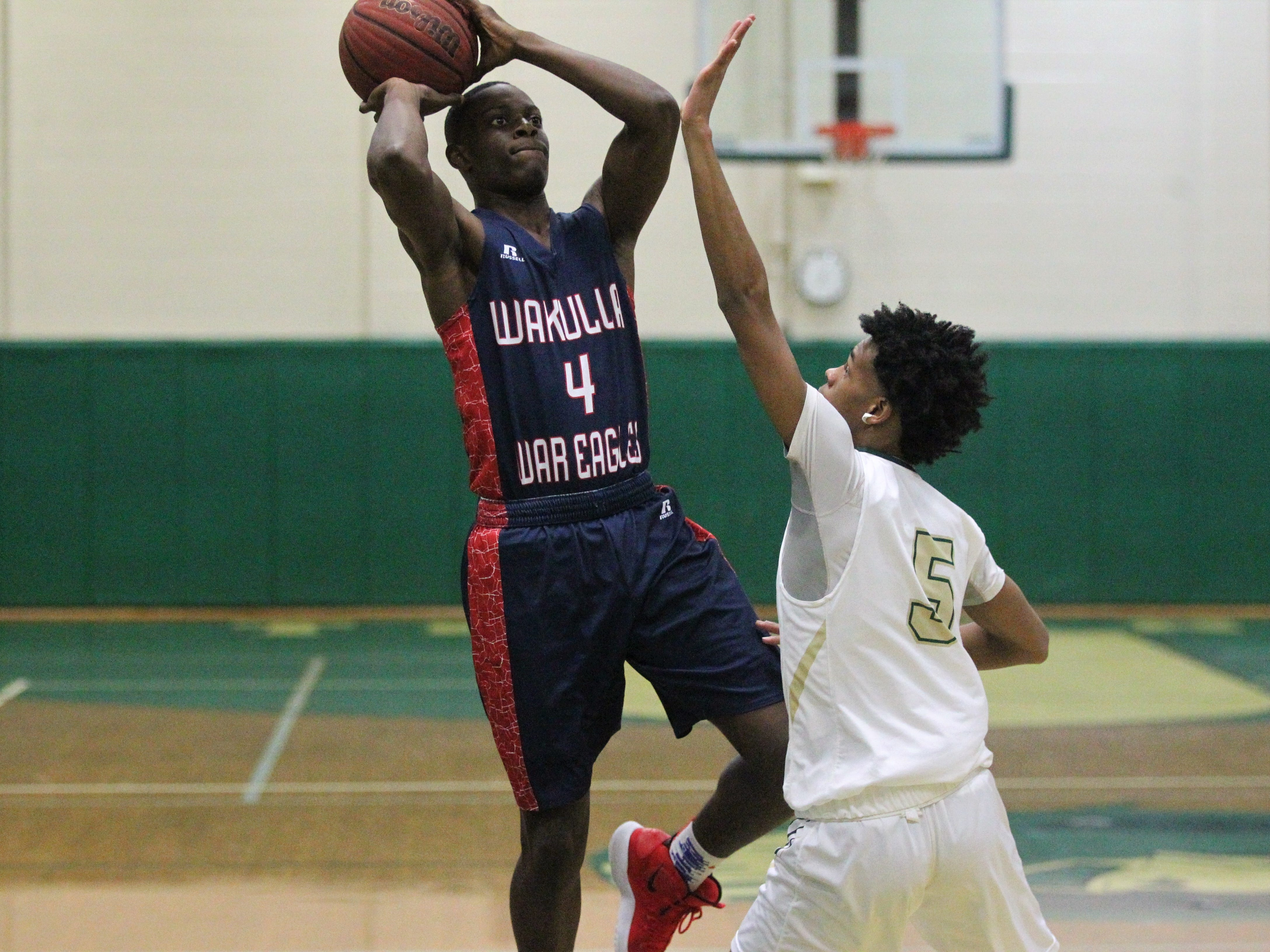 Wakulla's Trevon Hale takes an off-balance shot during Lincoln's 60-53 win on Jan. 10, 2019.